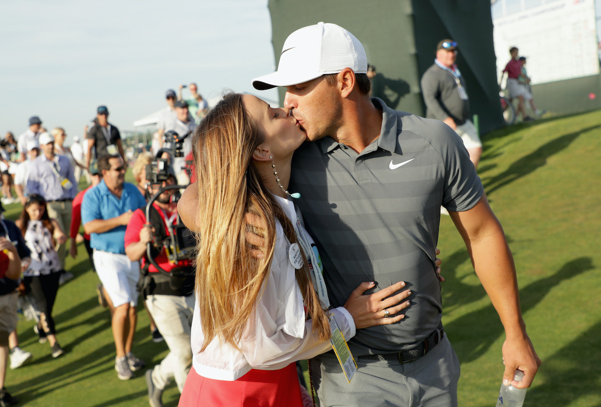 Brooks Koepka kisses girlfriend Jena Sims