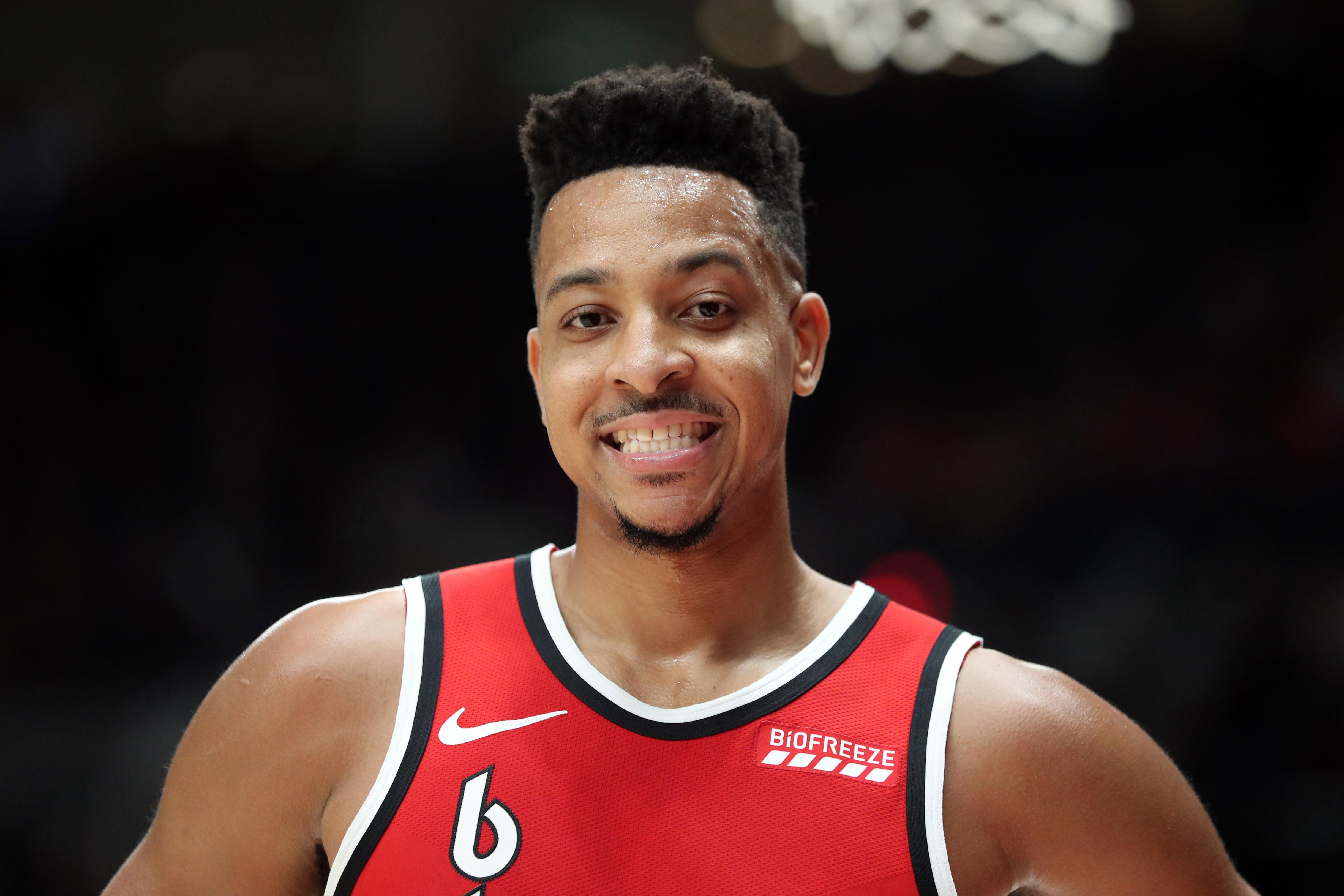 CJ McCollum of the Portland Trail Blazers smiles in the fourth quarter