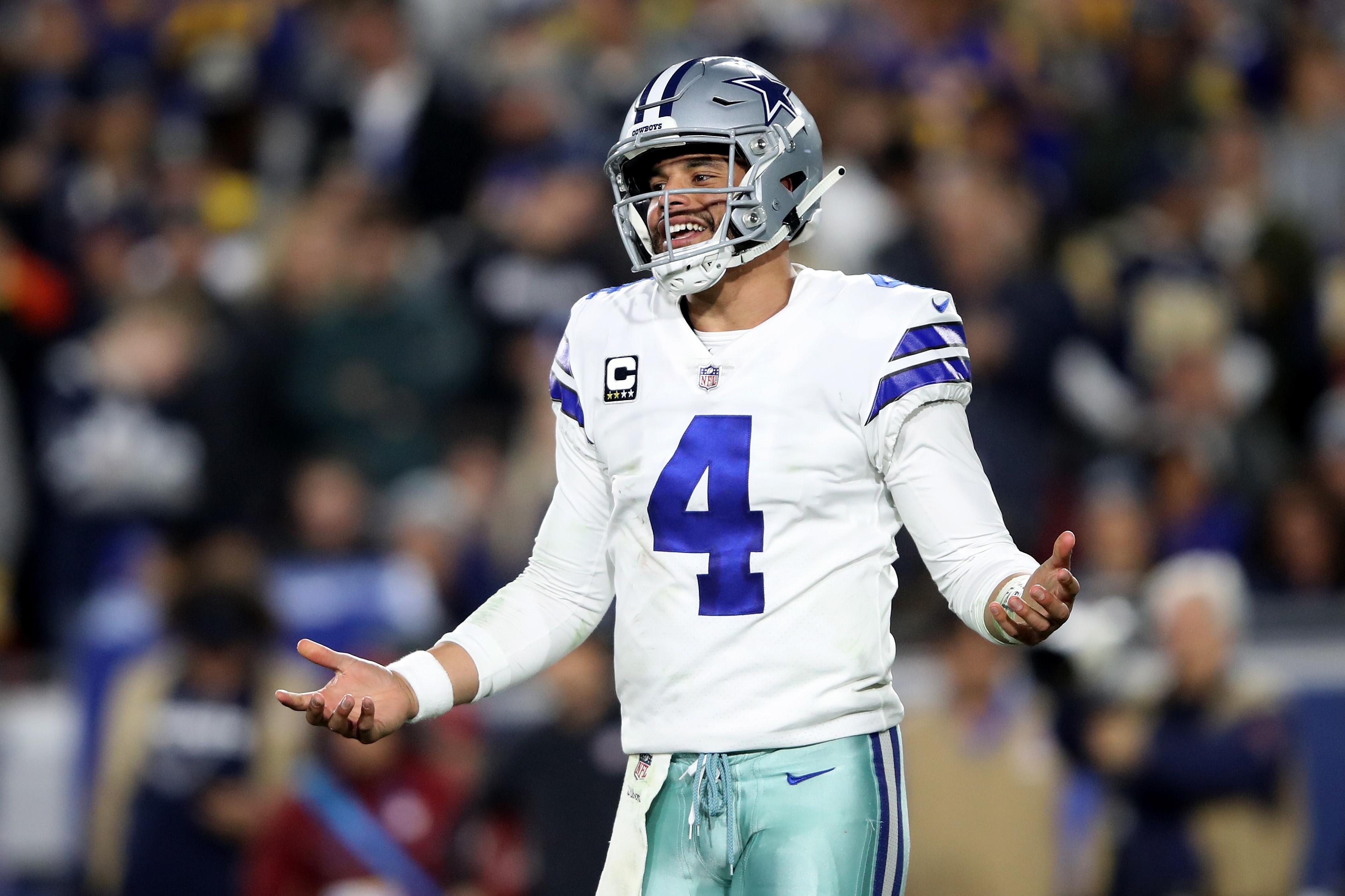Dak Prescott gestures during a Cowboys playoff game