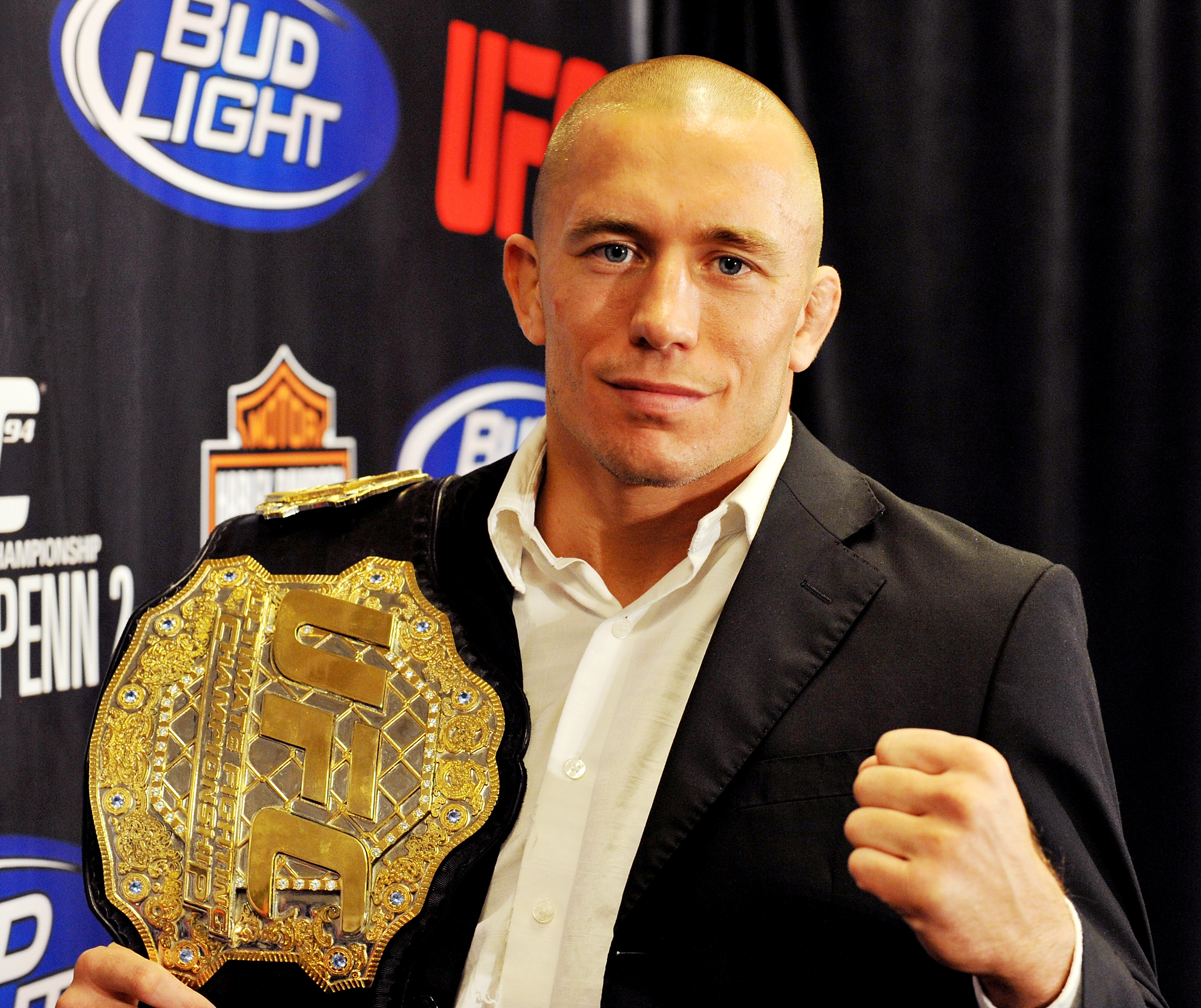 Georges St-Pierre poses with his UFC belt