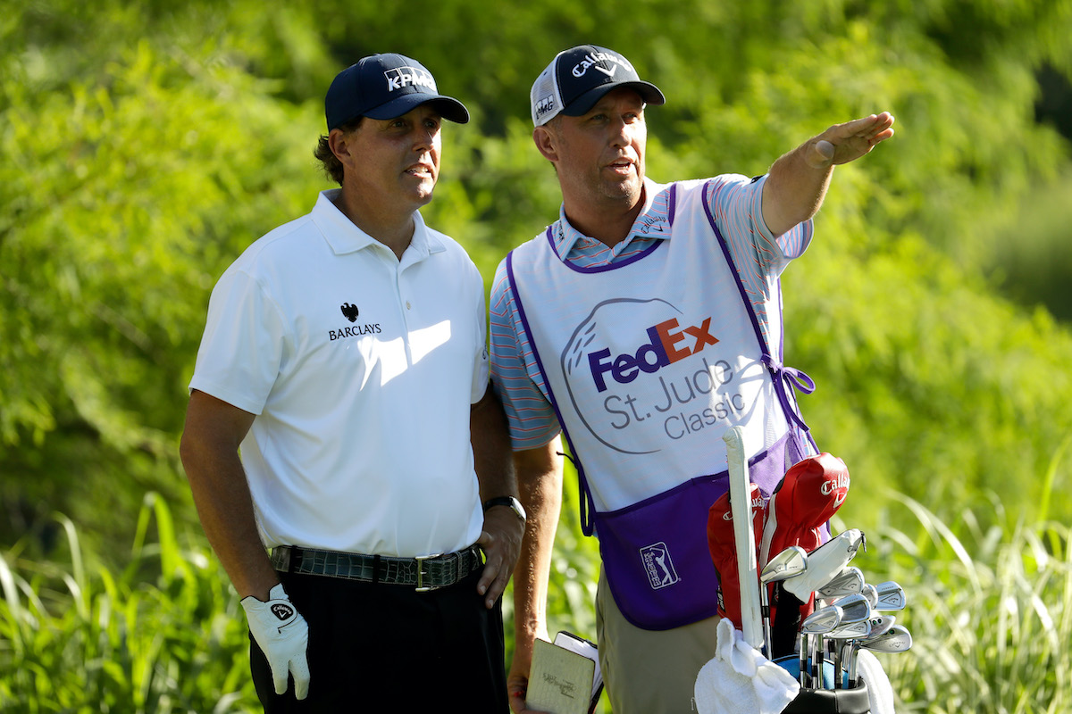 Golfer Phil Mickelson and caddie Jim Mackay in 2016