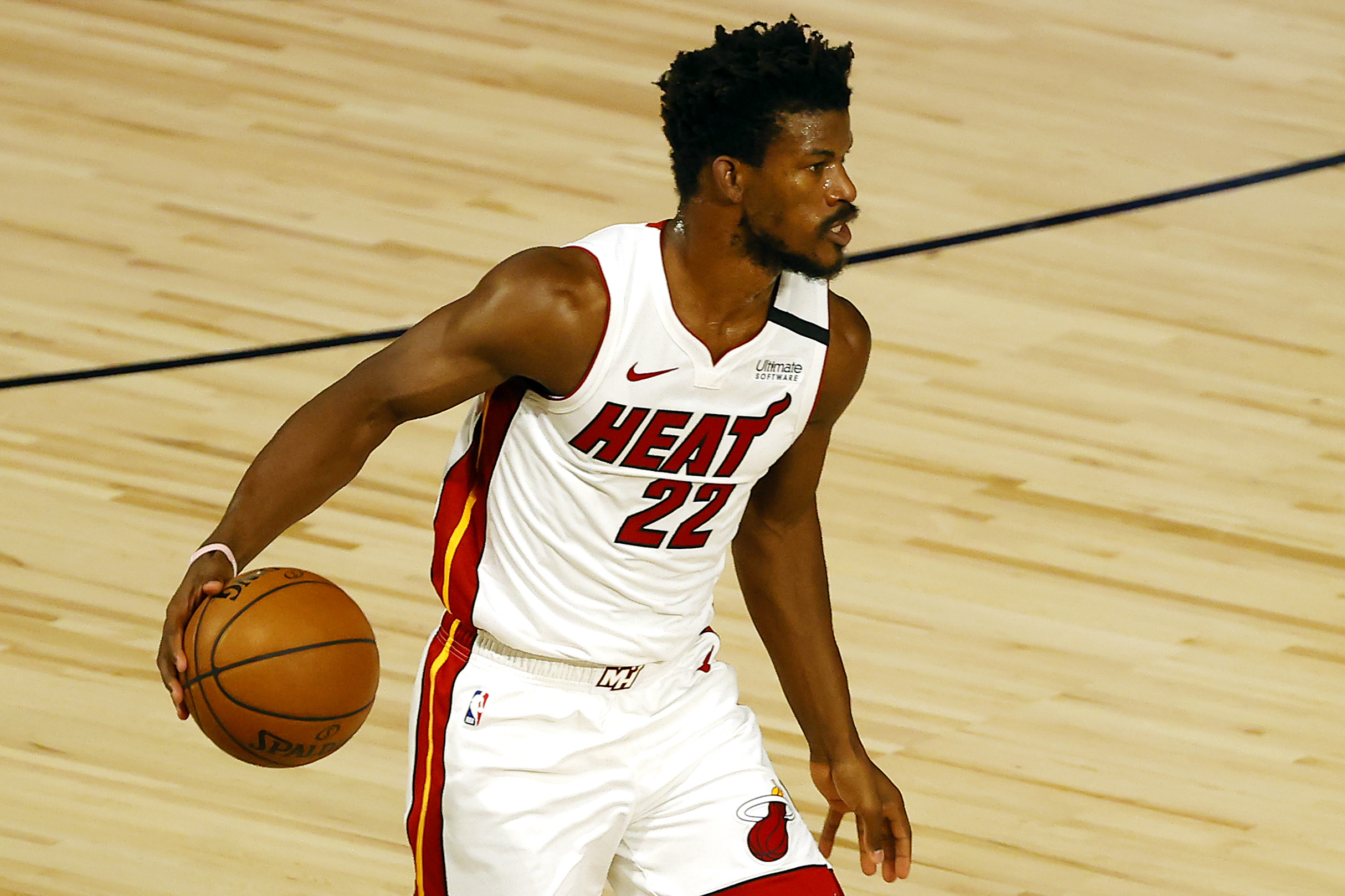Jimmy Butler dribbles the ball up the court during an NBA game