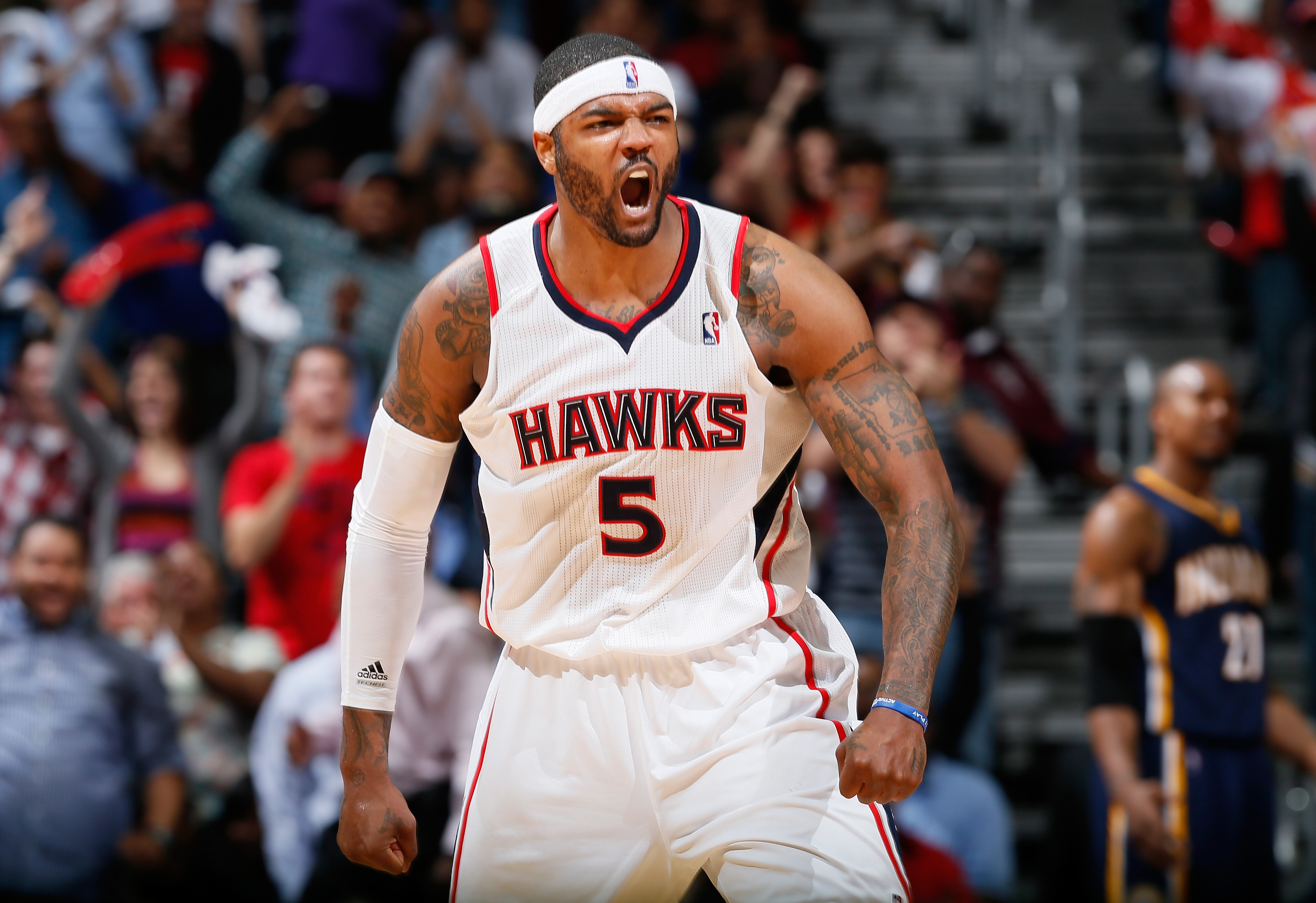 Josh Smith celebrates after making a shot during a Hawks game
