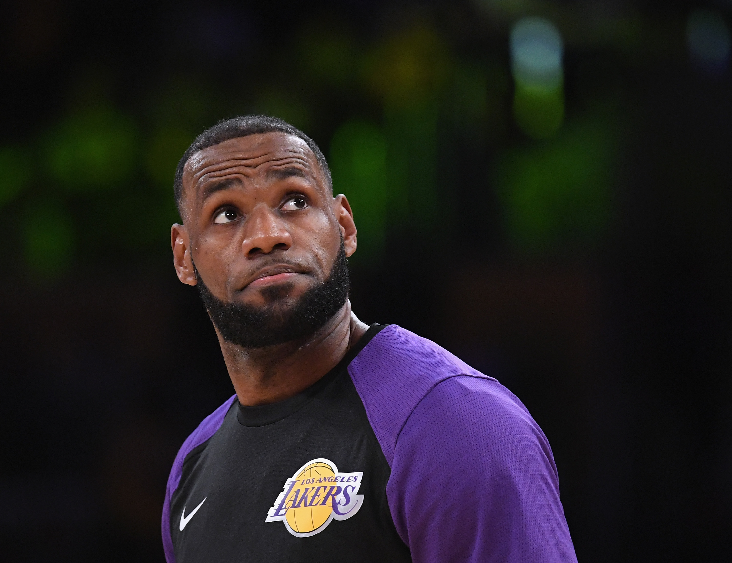 LeBron James looking on before the start of a Lakers game