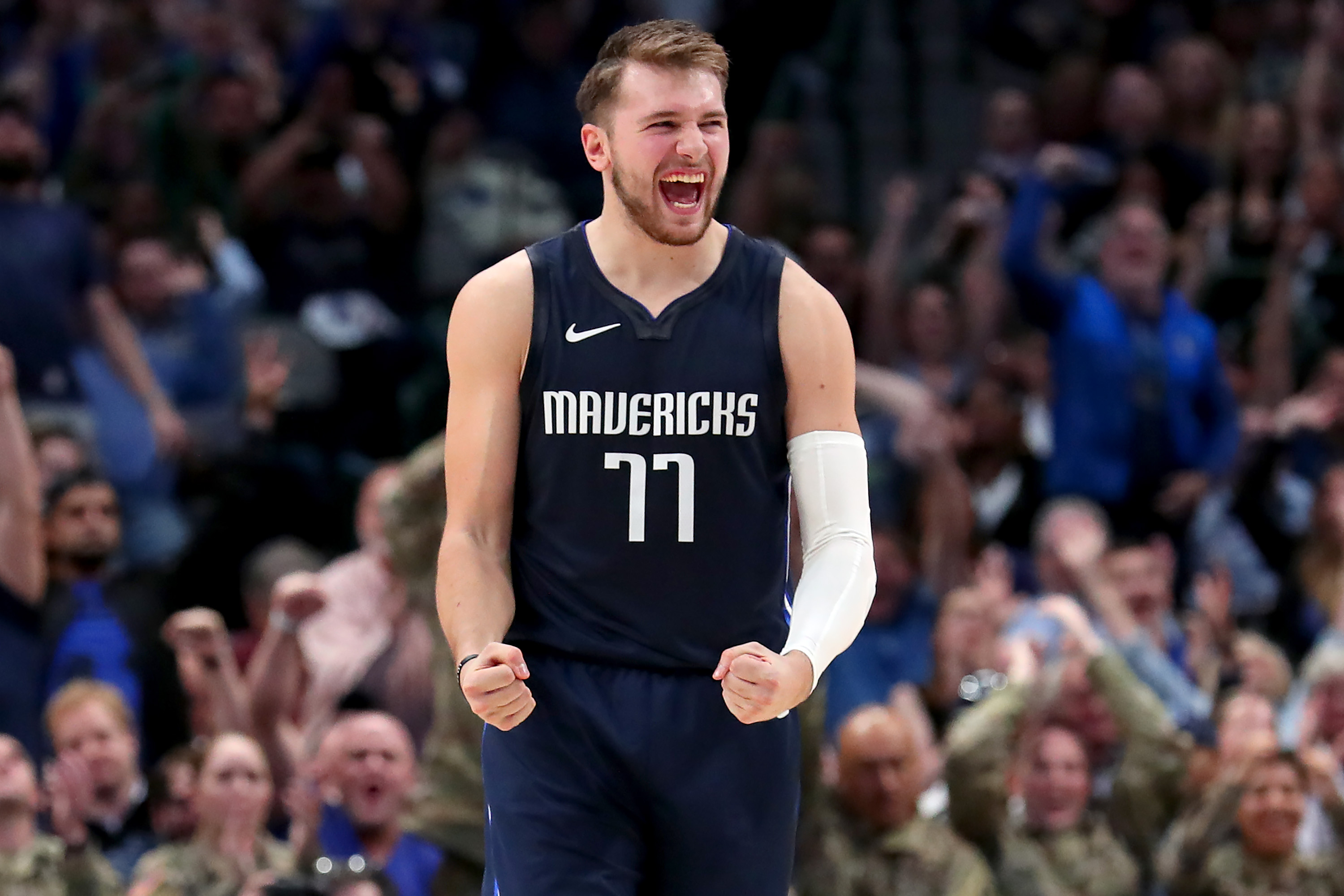 Luka Doncic celebrates after making a shot