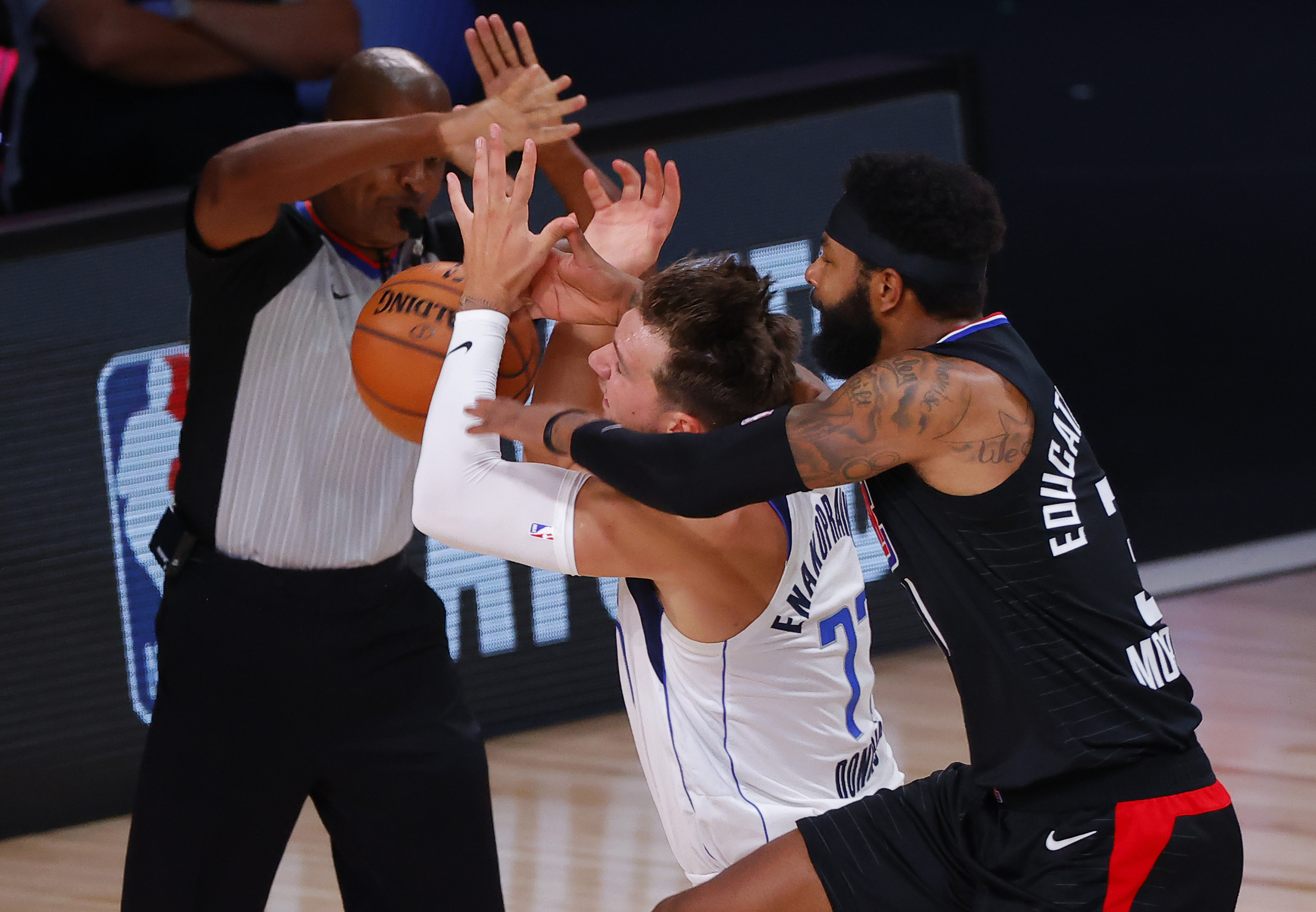 Luka Doncic Blasts Marcus Morris and Morris Fires Right Back
