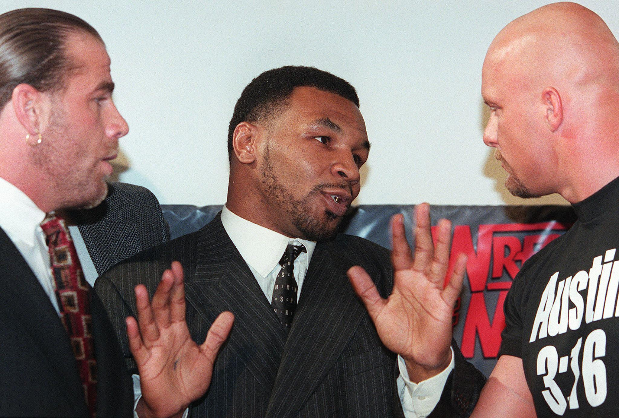 Mike Tyson talking to wrestlers Shawn Michaels and Steve Austin