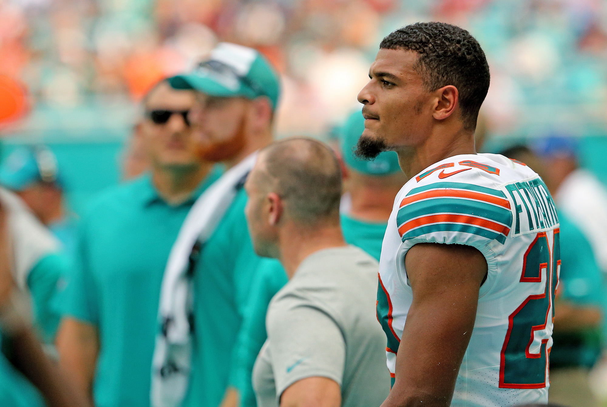 Minkah Fitzpatrick stands on the sideline during a Dolphins game