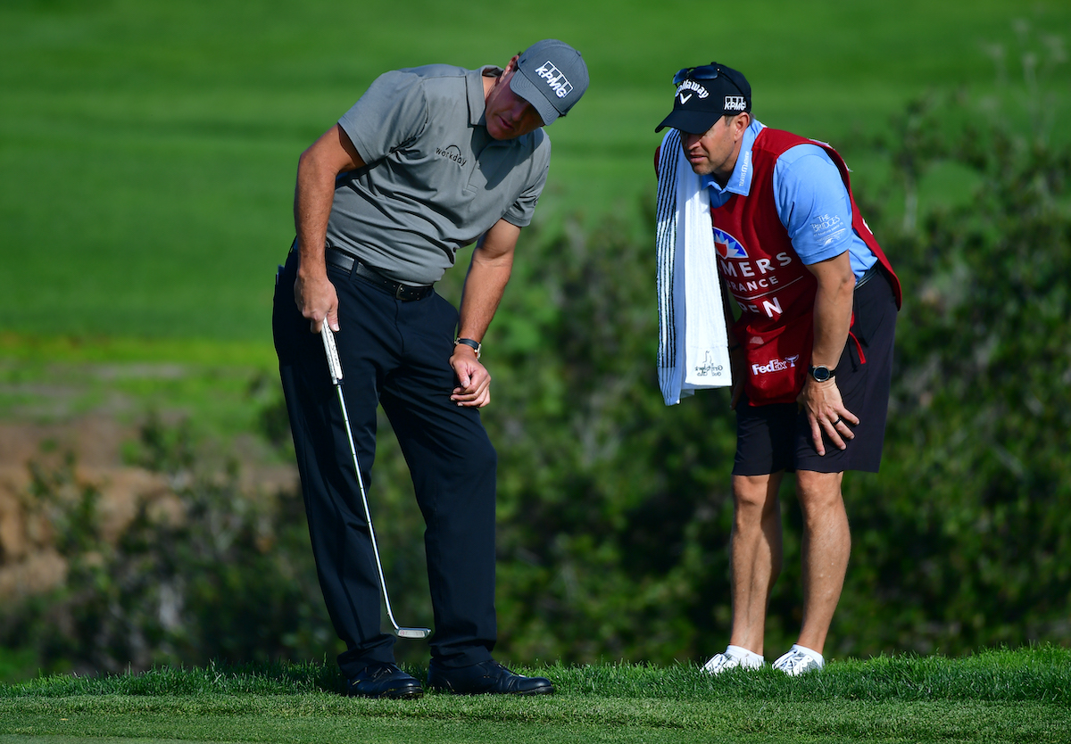 Golfer Phil Mickelson and caddie Tim Mickelson