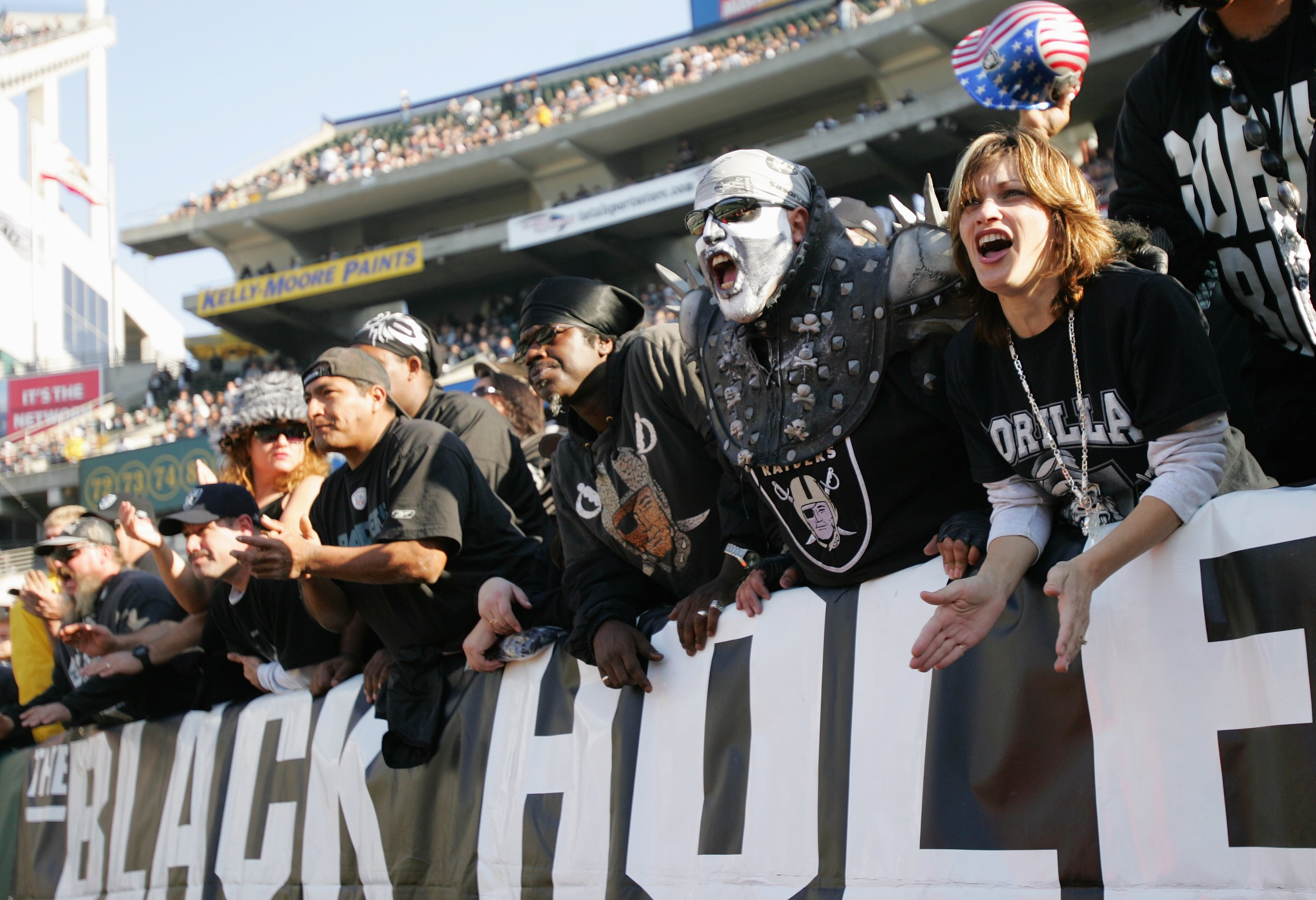 Raiders fans cheering during a game