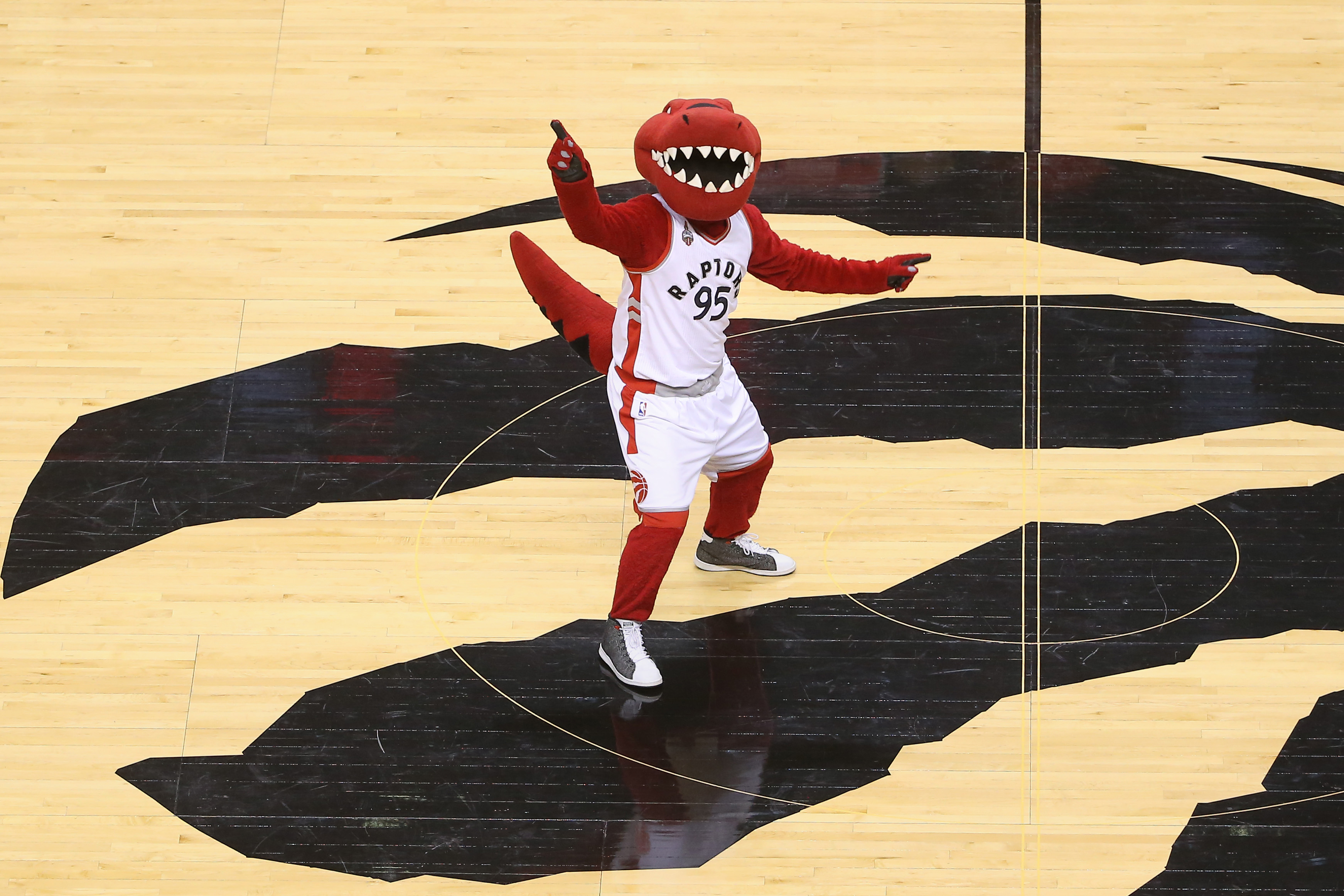 The Toronto Raptors NBA mascot standing on the court before a game