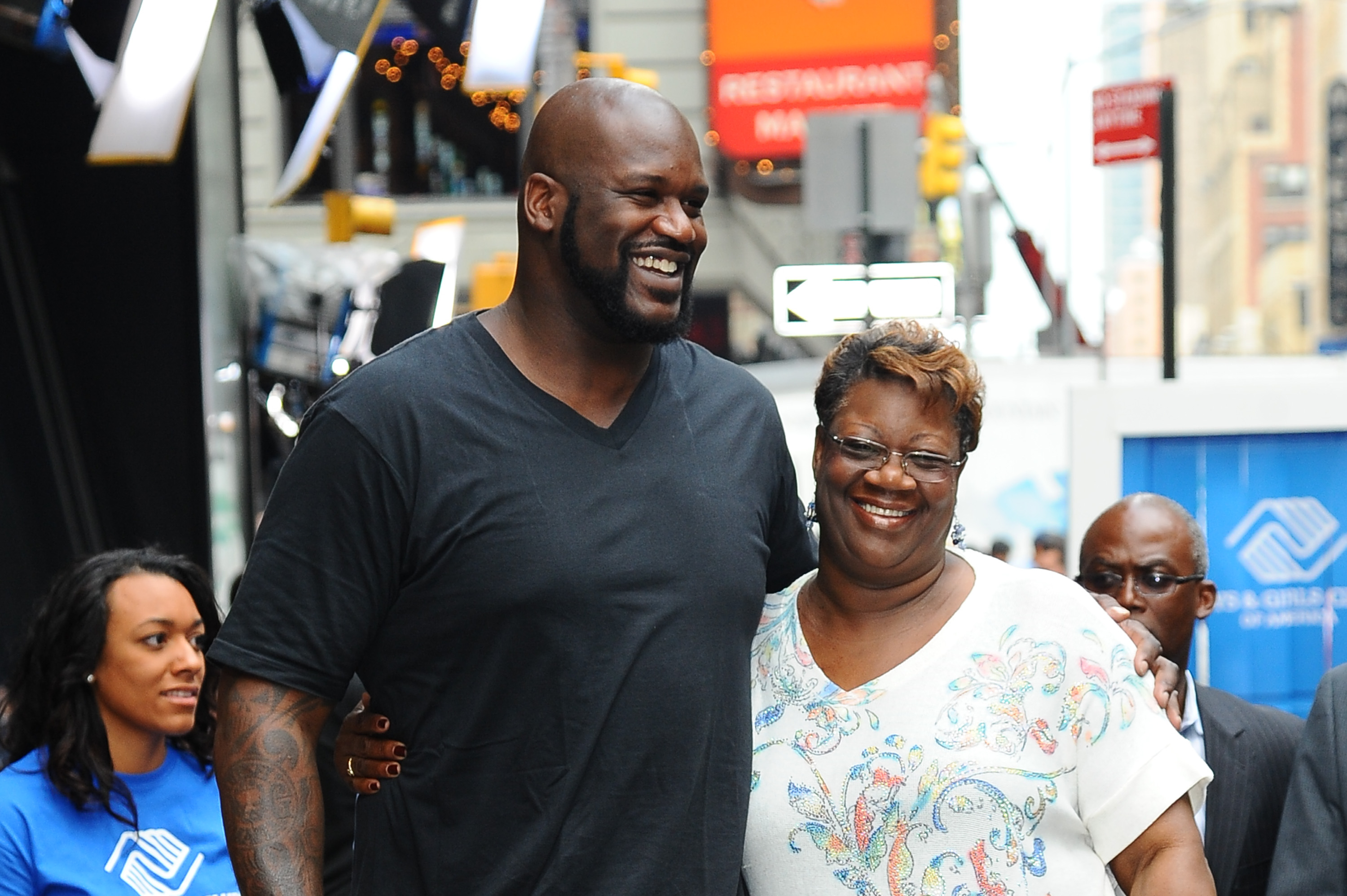 Shaquille O'Neal and his mom posing for a picture