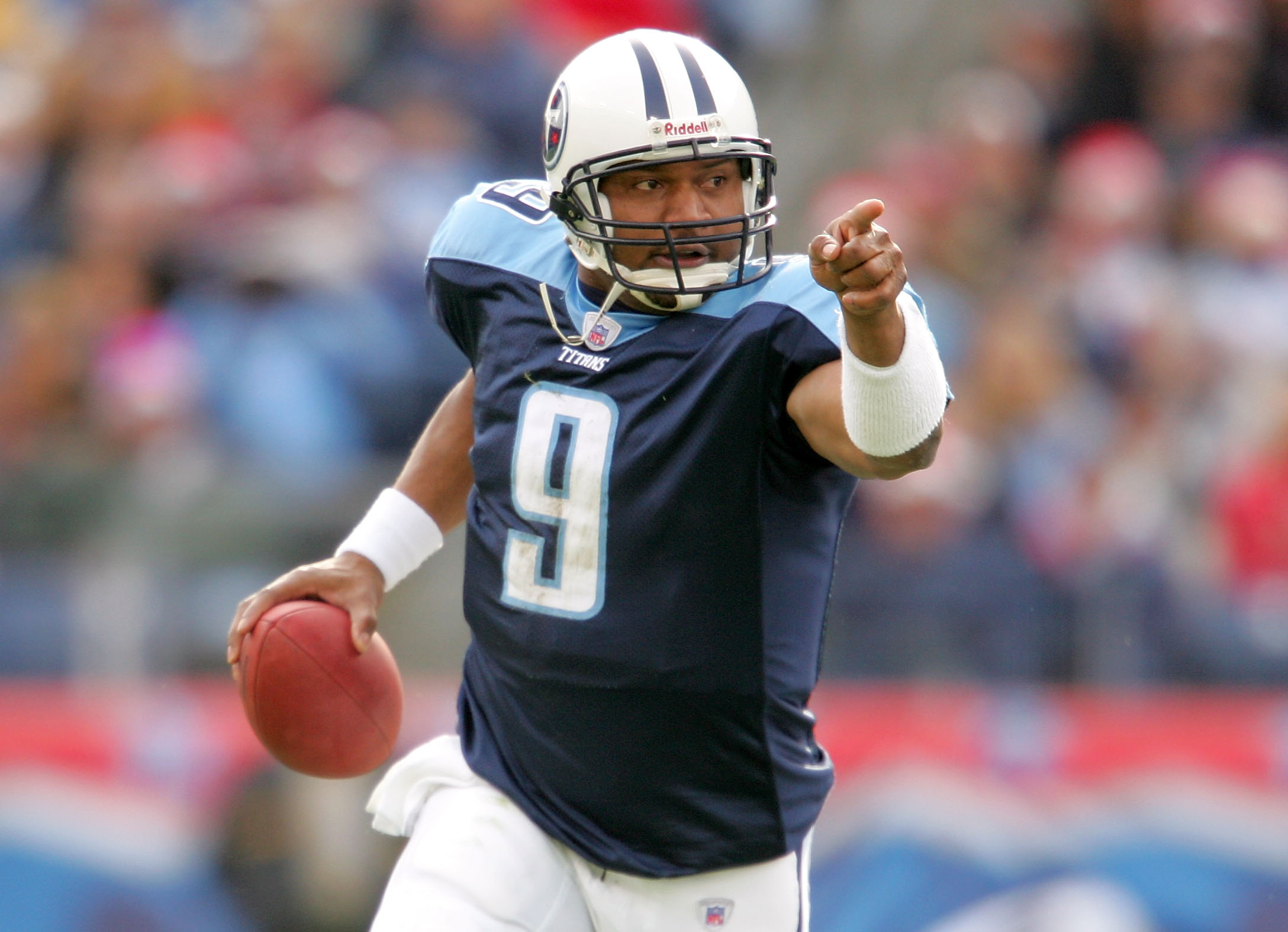 Steve McNair looking downfield for a receiver to throw to
