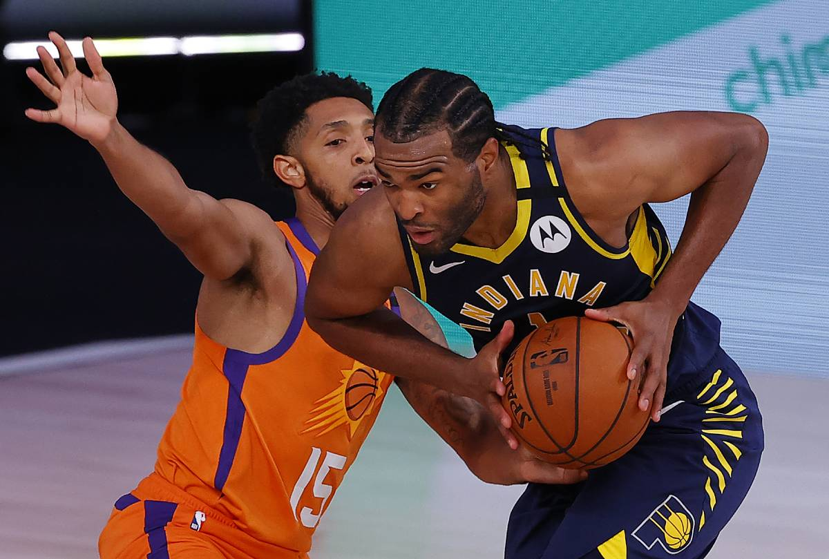 Indiana Pacers forward T.J. Warren (R) is reviving his career in the NBA's bubble.