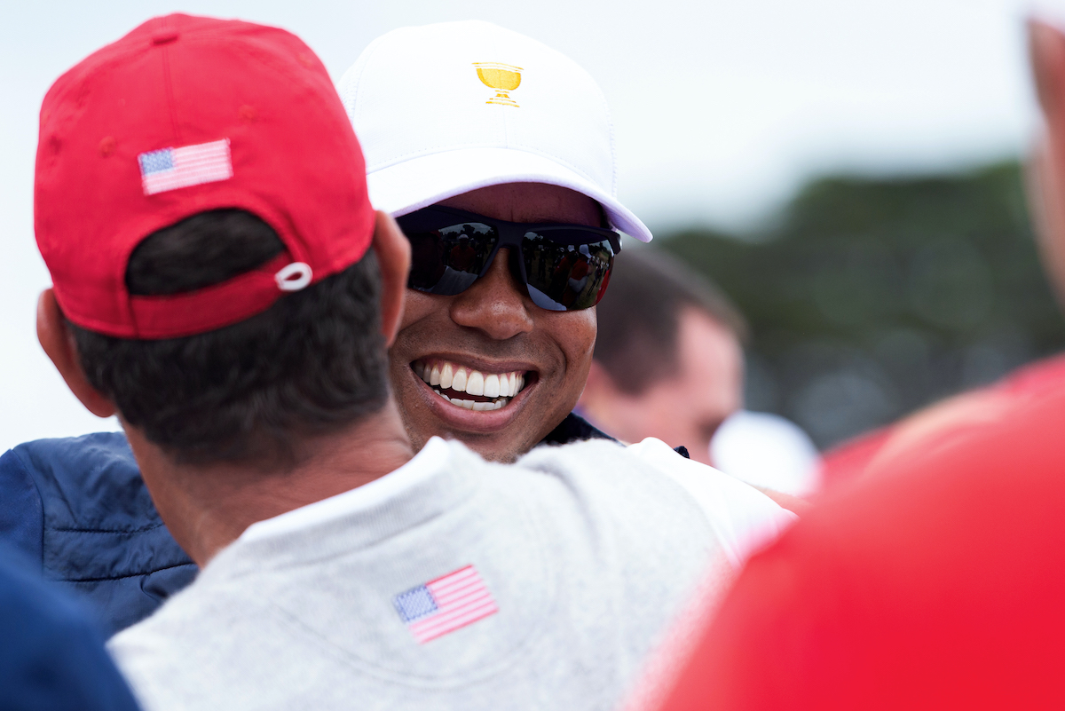 Tiger Woods of team USA celebrates with his team during the final round of the 2019 Presidents Cup