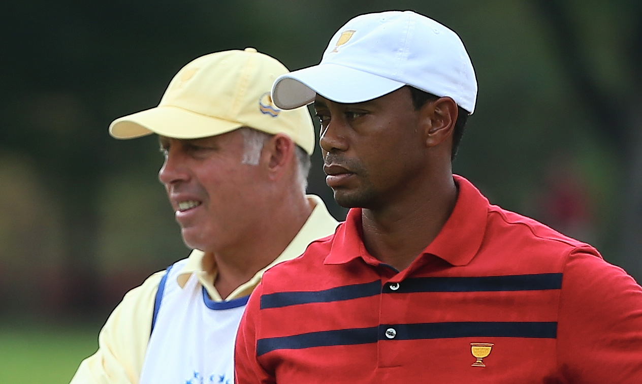Tiger Woods and his caddie Steve Williams look on