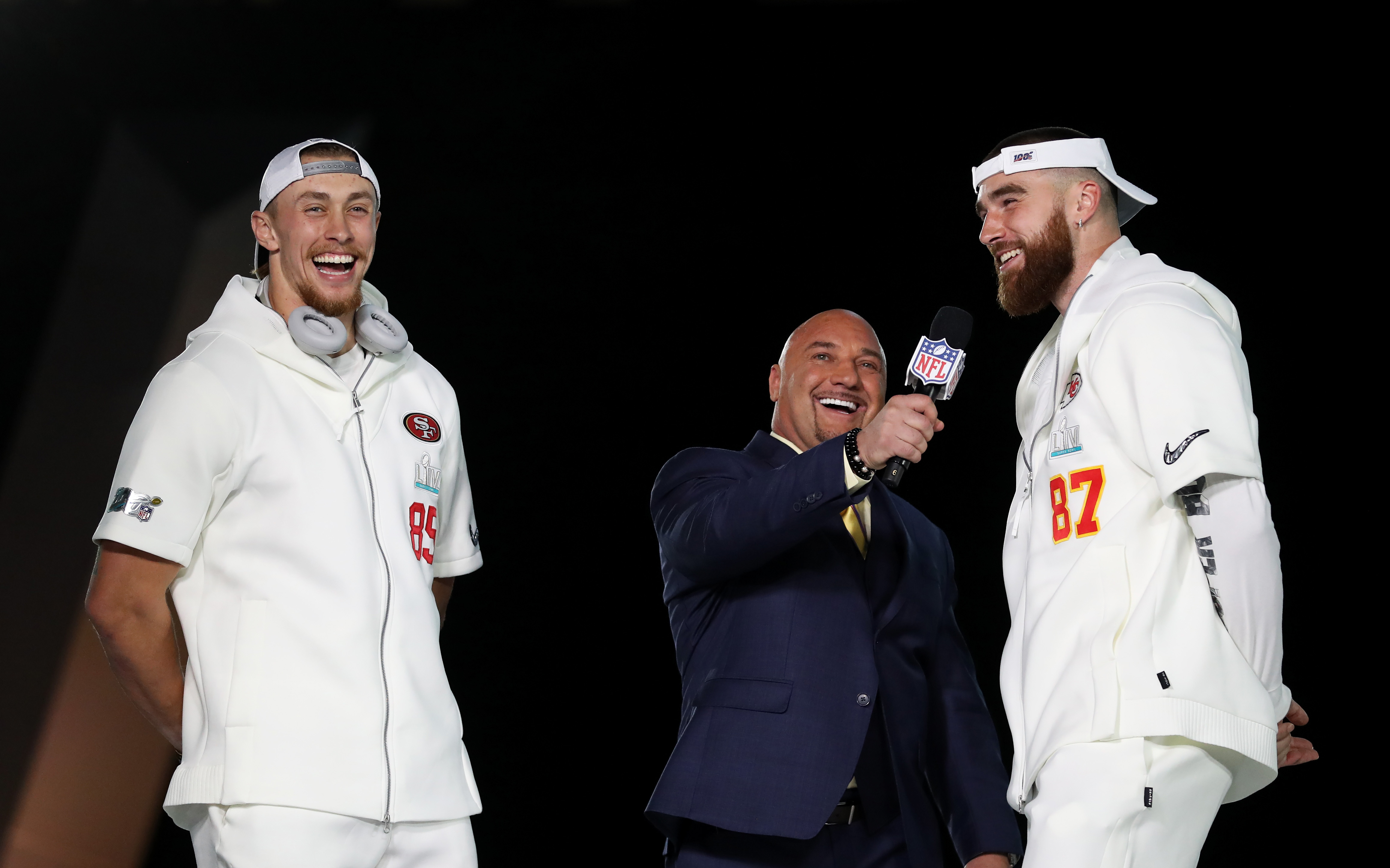 Travis Kelce and George Kittle giving an interview before the Super Bowl