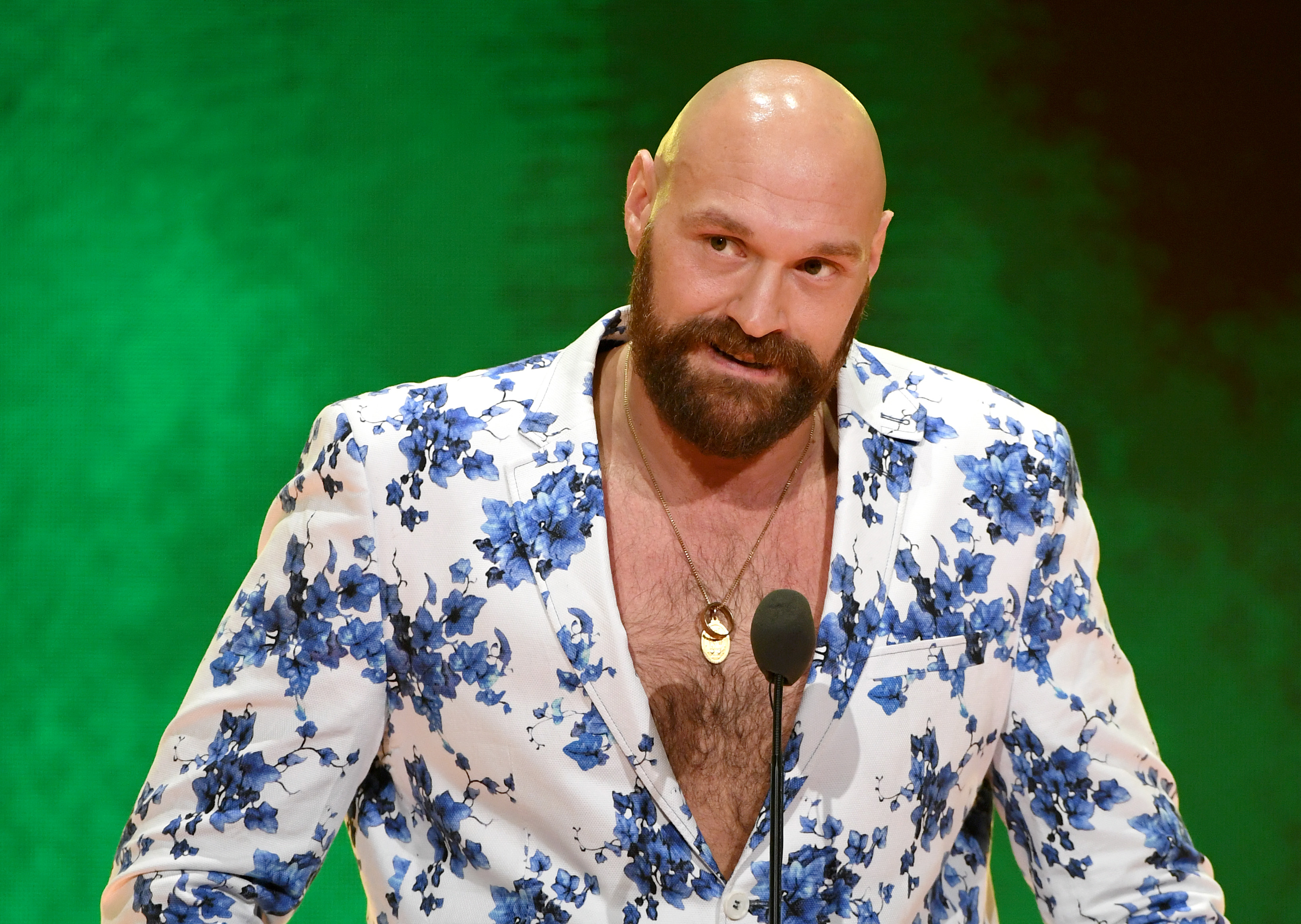 Tyson Fury speaking at a WWE news conference