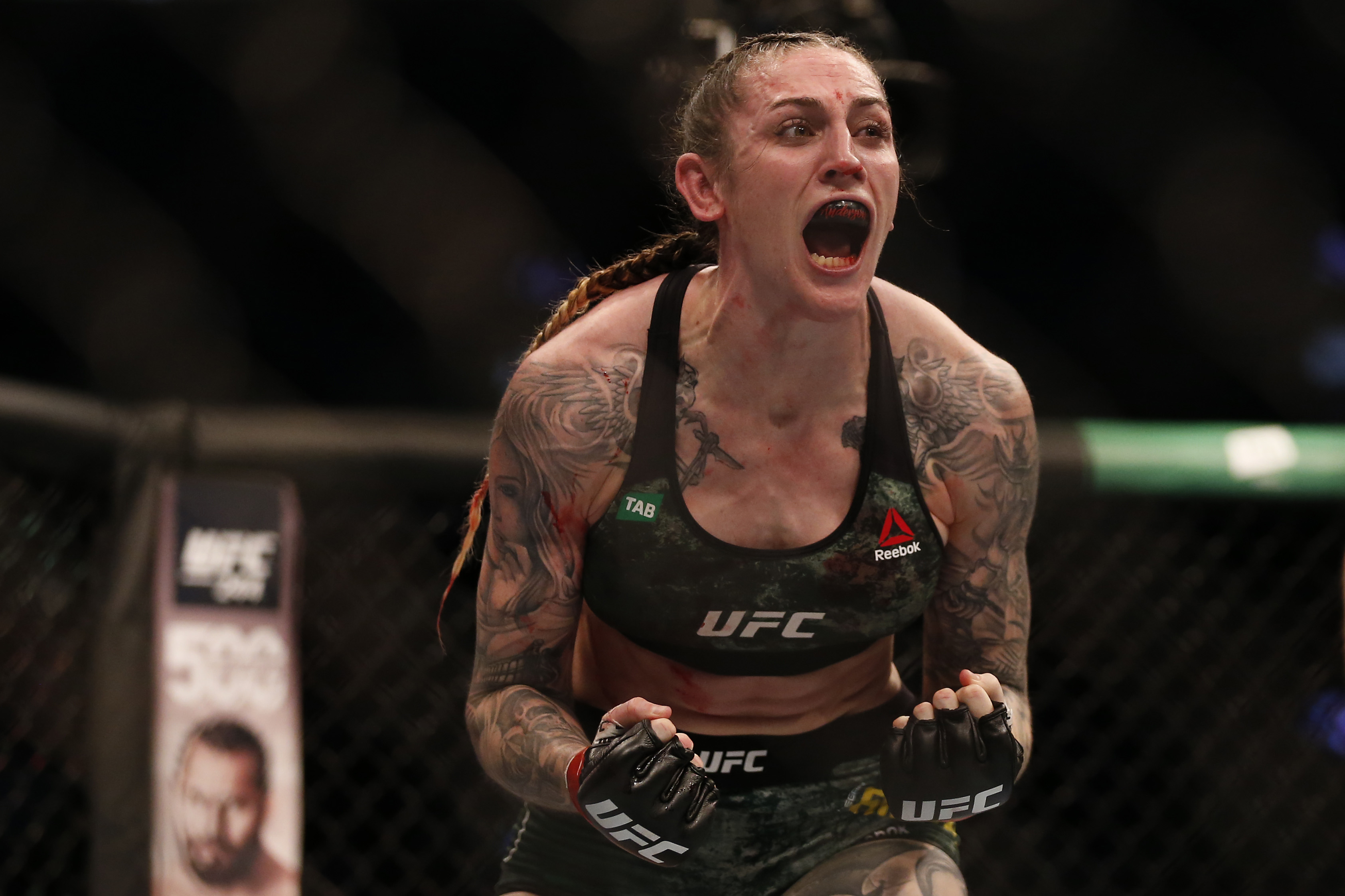 Megan Anderson celebrating a UFC win