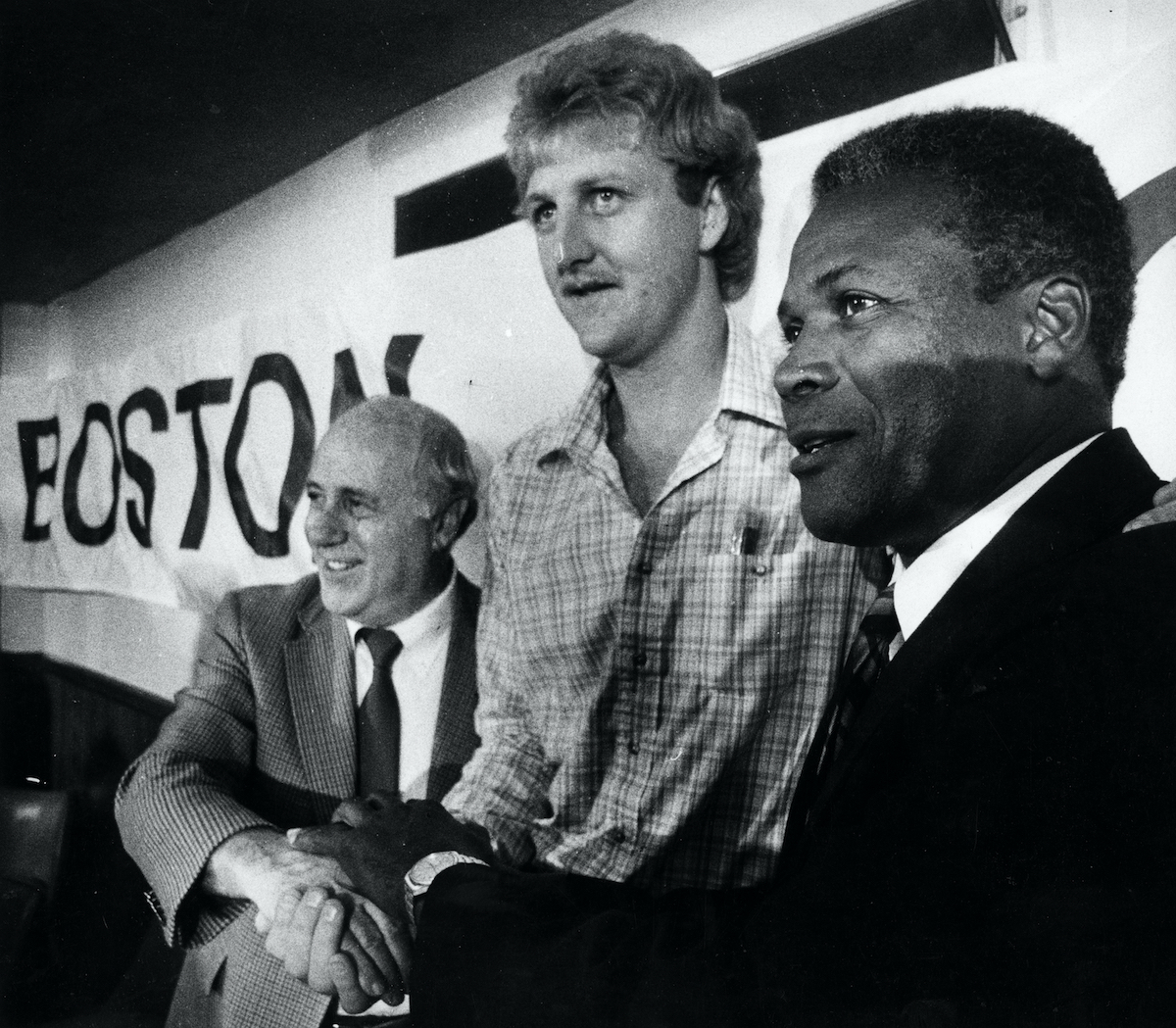 Celtics' general manager Red Auerbach, Larry Bird, and coach K.C. Jones