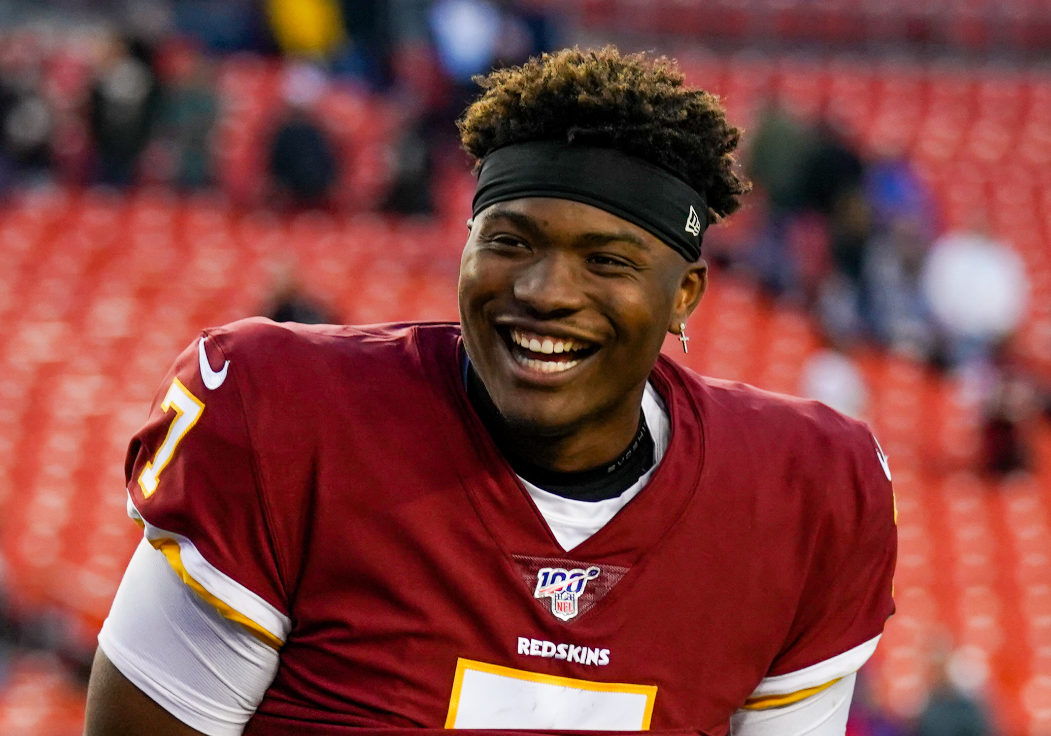 Dwayne Haskins smiles on the sideline
