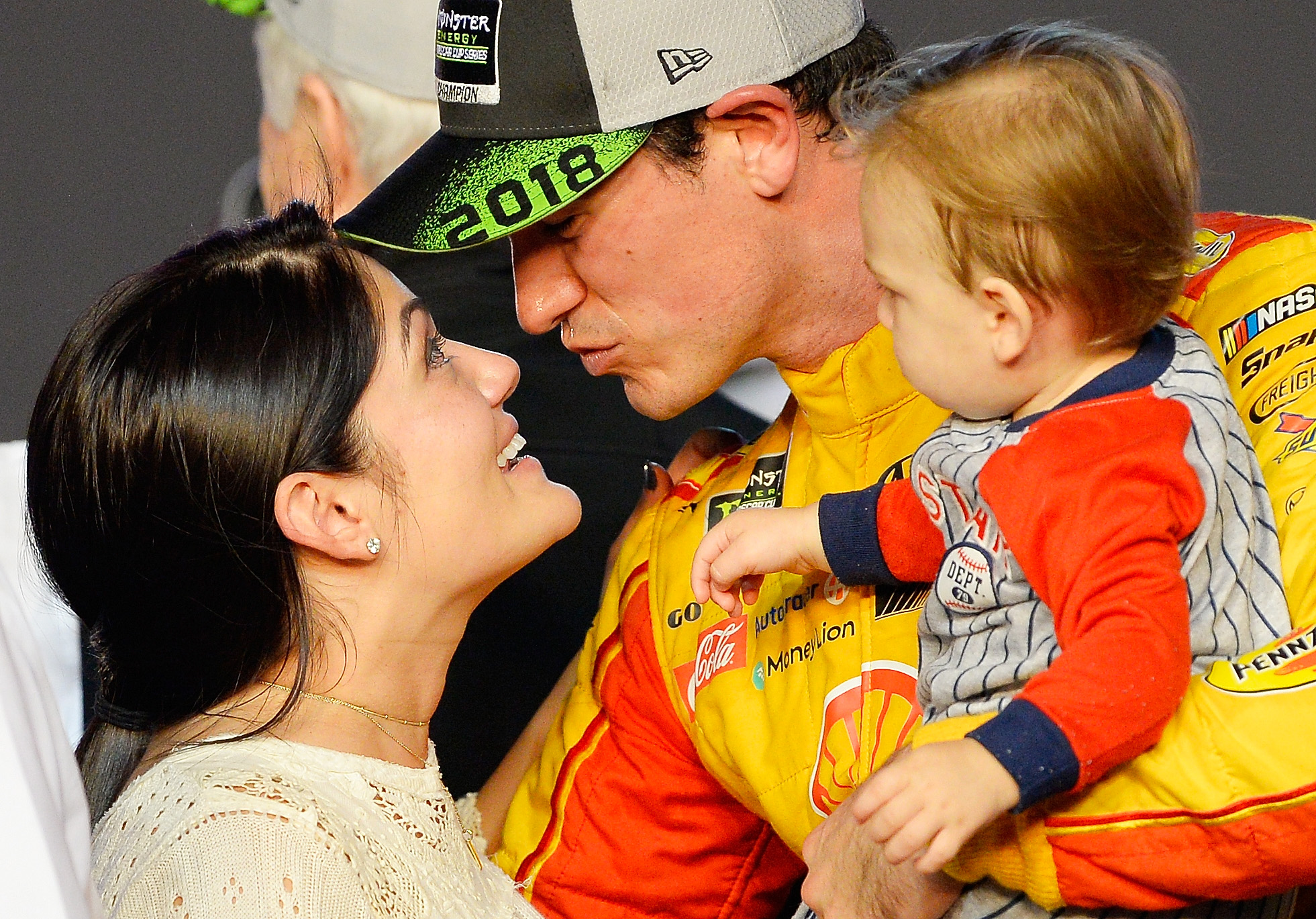 NASCAR driver Joey Logano with his wife and son