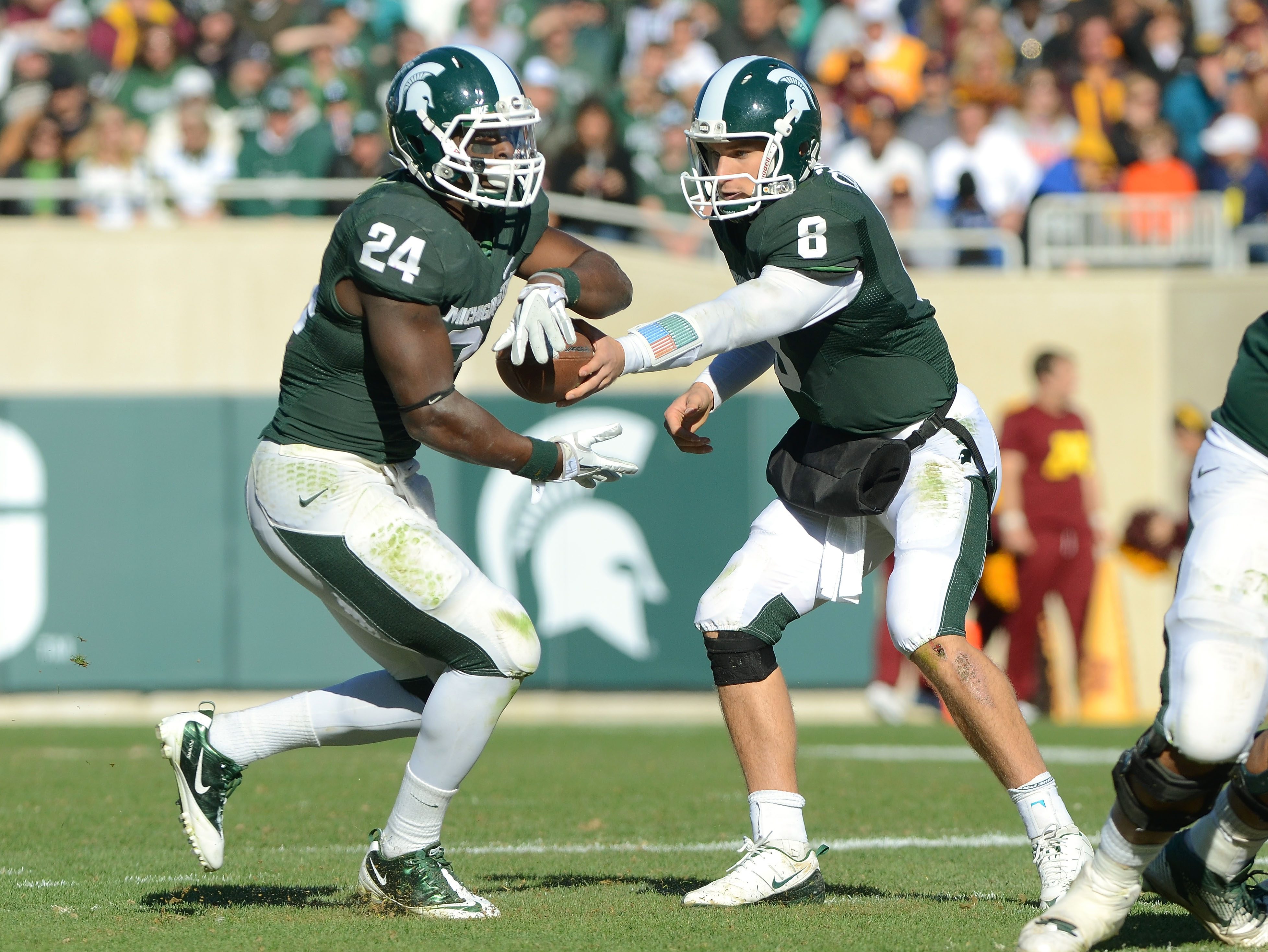 Michigan State Spartans' Kirk Cousins and Le'Veon Bell