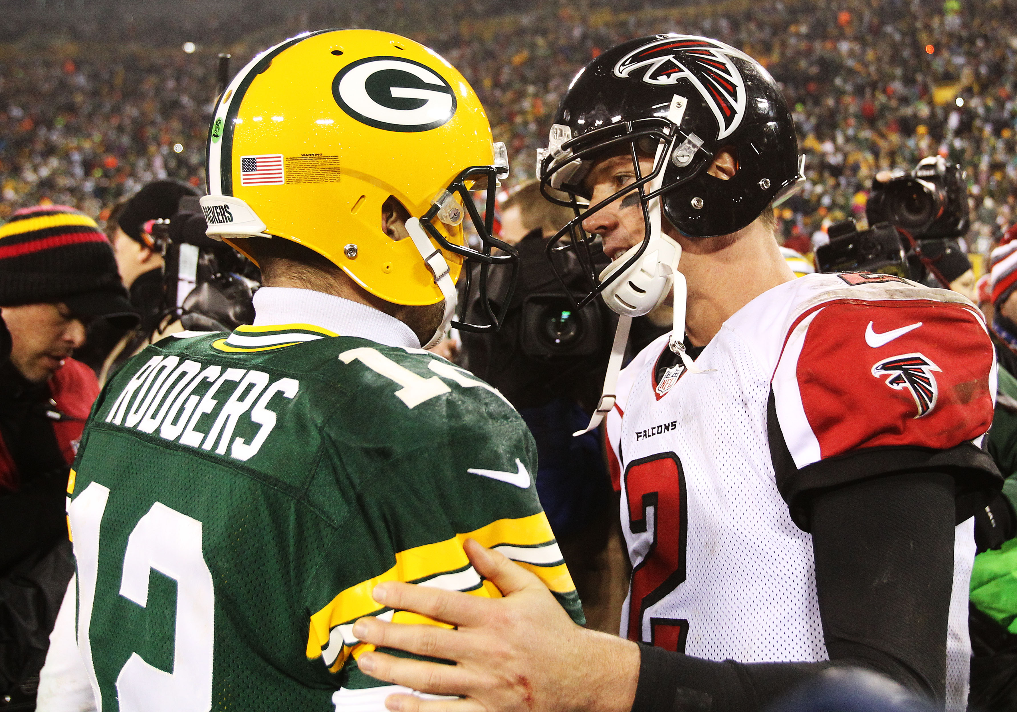 Matt Ryan and Aaron Rodgers talk at midfield after a game