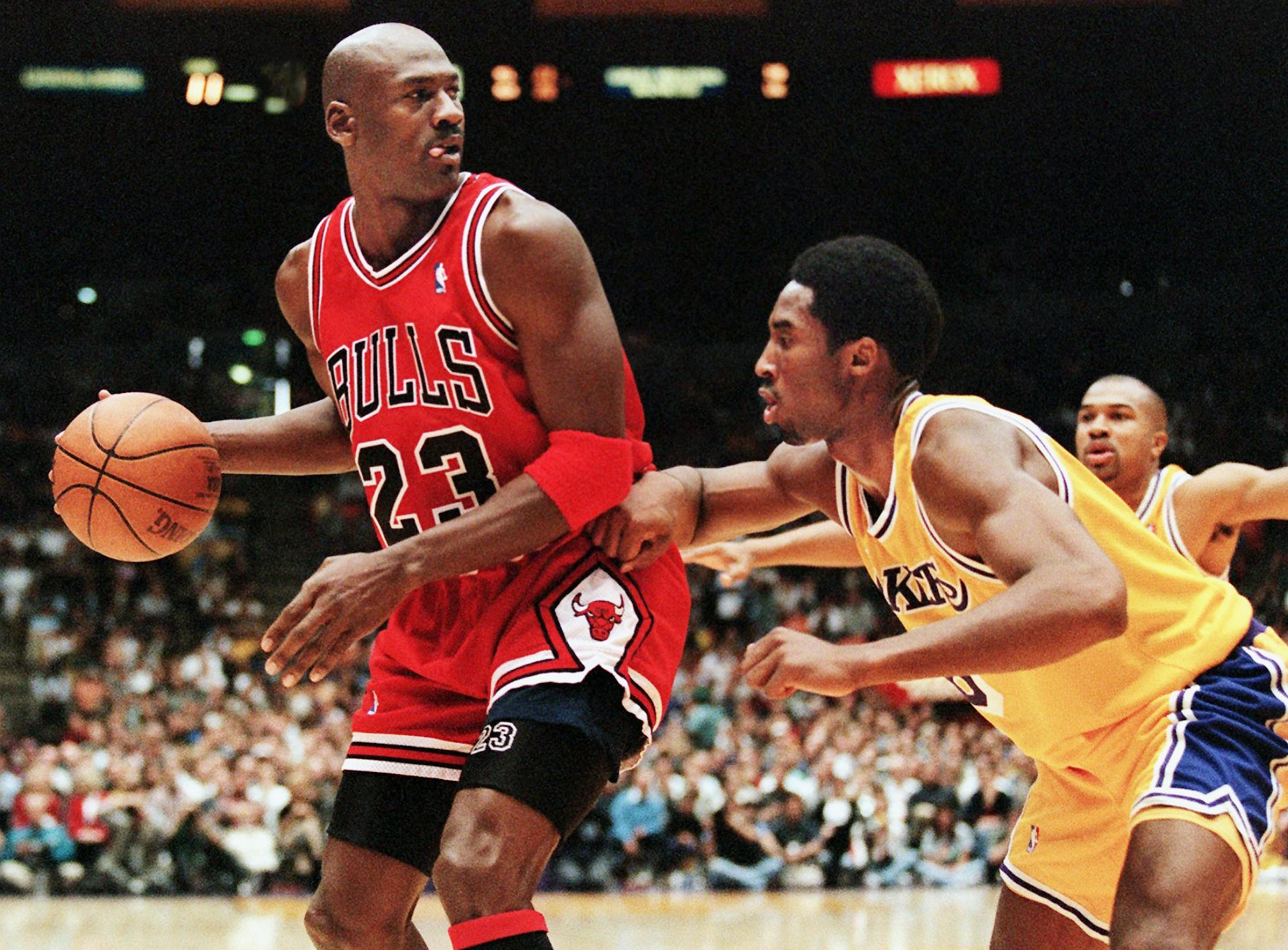 Kobe Bryant defends Michael Jordan during a game