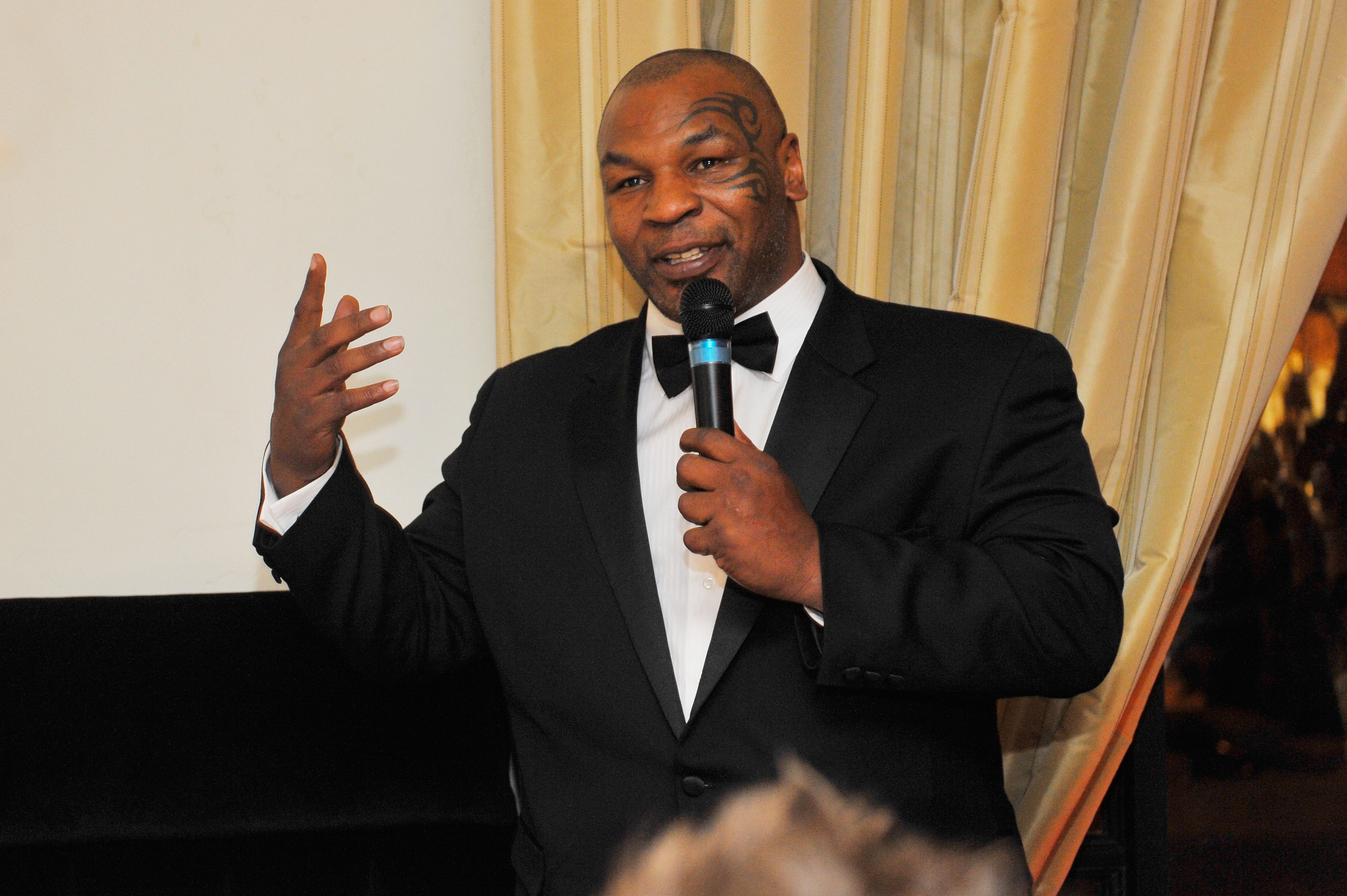 Mike Tyson talking at a dinner event
