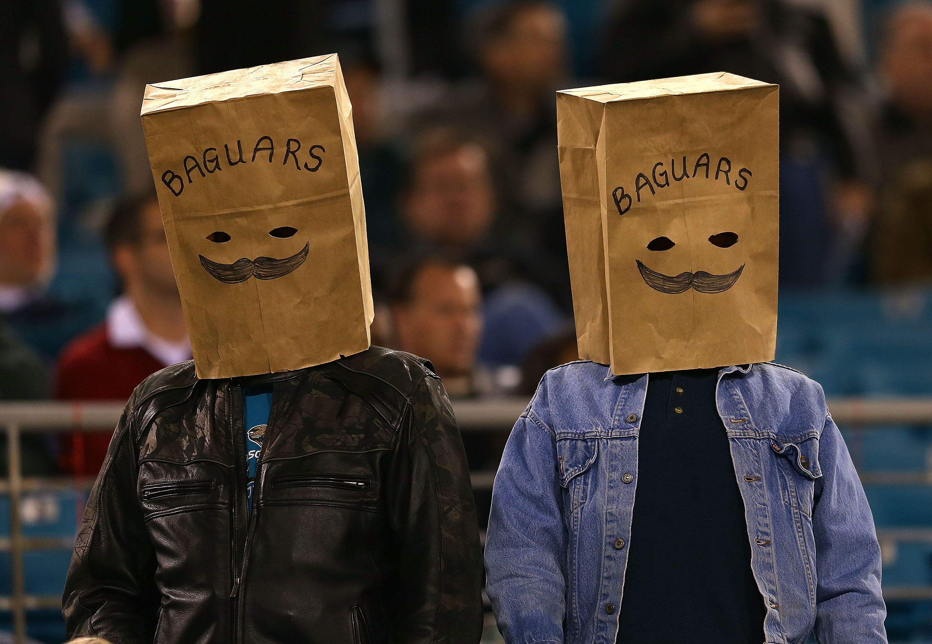 Jacksonville Jaguars fans wear bags over their head during an NFL Game