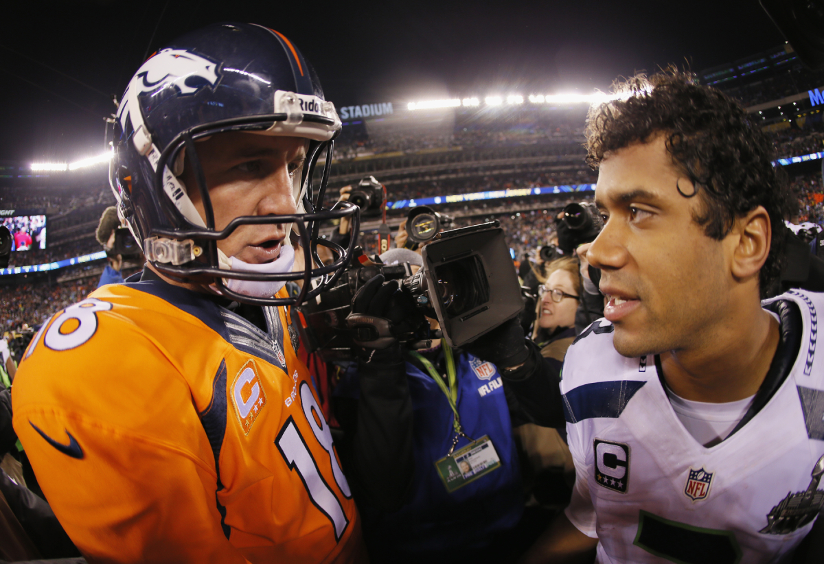 Peyton Manning and Russell Wilson shake hands after the Super Bowl
