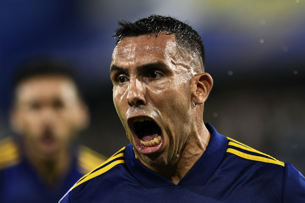 Carlos Tevez celebrates after scoring