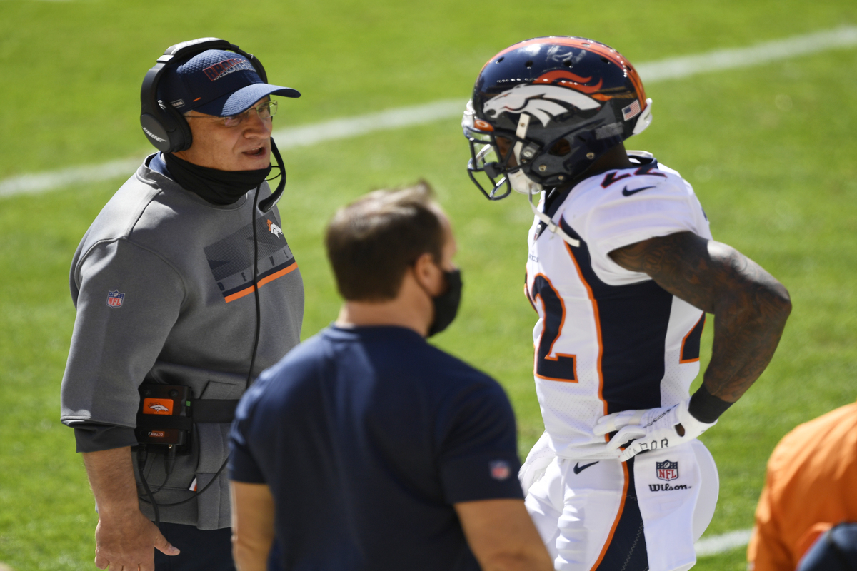 Broncos head coach Vic Fangio (L) received a hefty fine for not wearing his mask on the sidelines.
