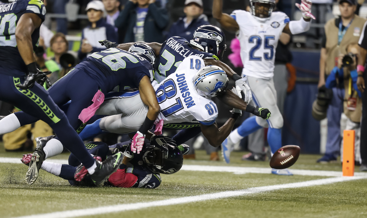 Calvin Johnson of the Detroit Lions gets tackled