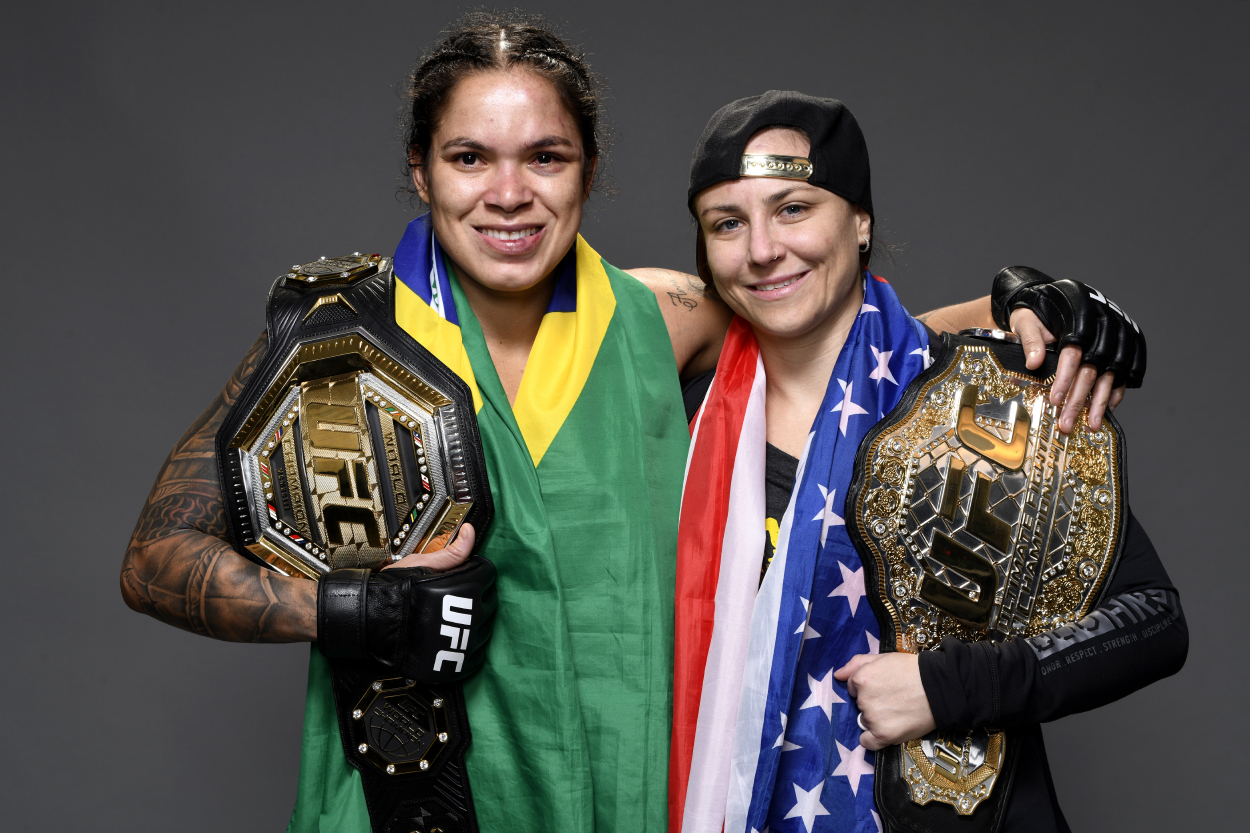 Amanda Nunes and Nina Ansaroff pose with their UFC belts