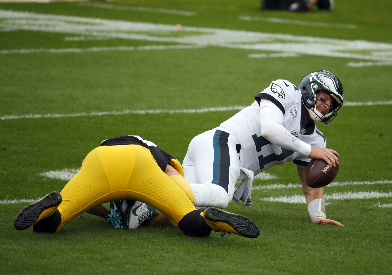 Carson Wentz getting sacked in a game against the Steelers