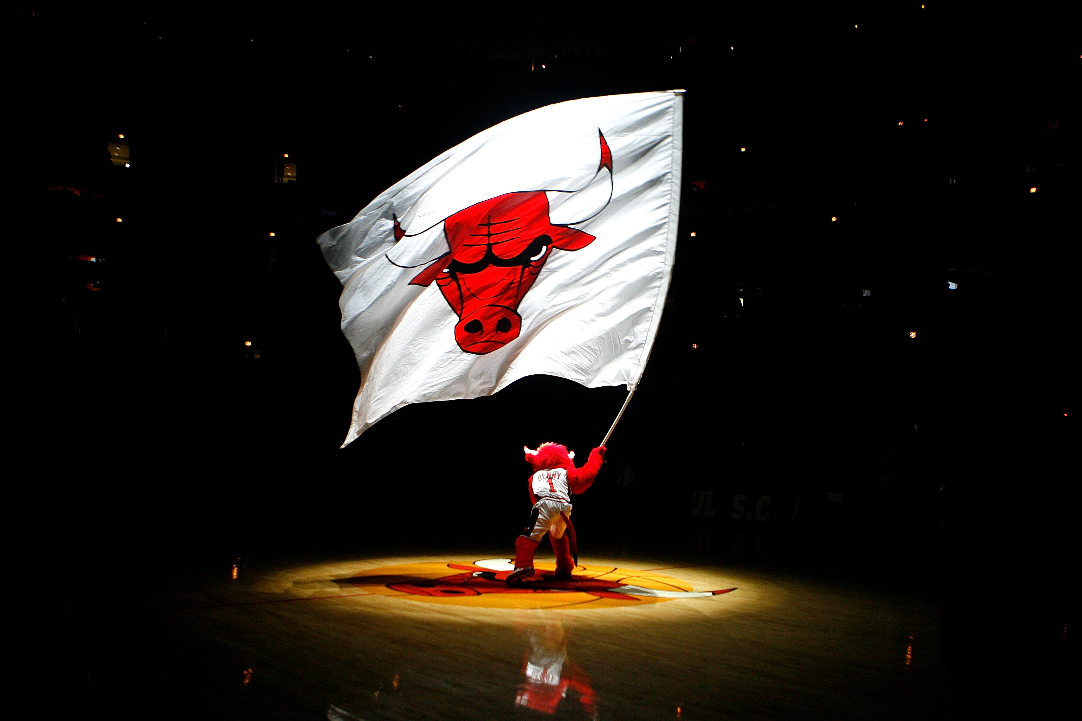 Benny the Bull, mascot for the Chicago Bulls, waves a giant flag with the Bulls' logo on it