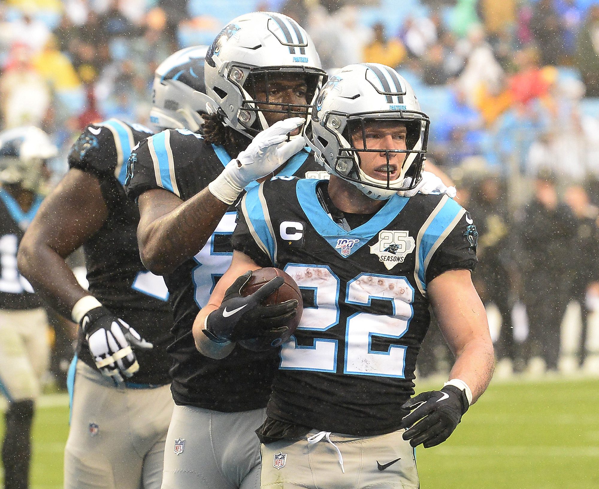 Christian McCaffrey celebrates after a run