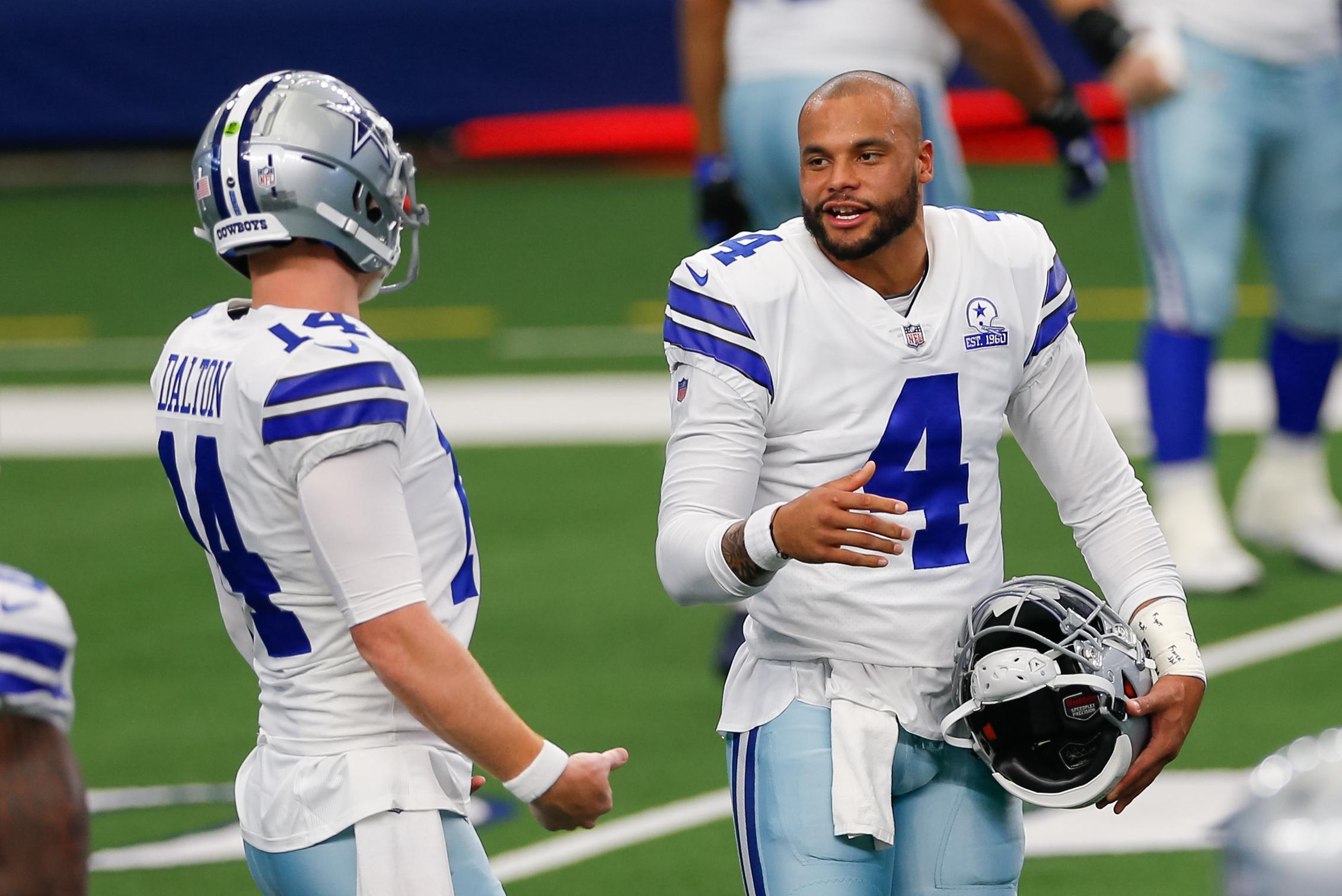 Dak Prescott talking to Andy Dalton before a Cowboys game