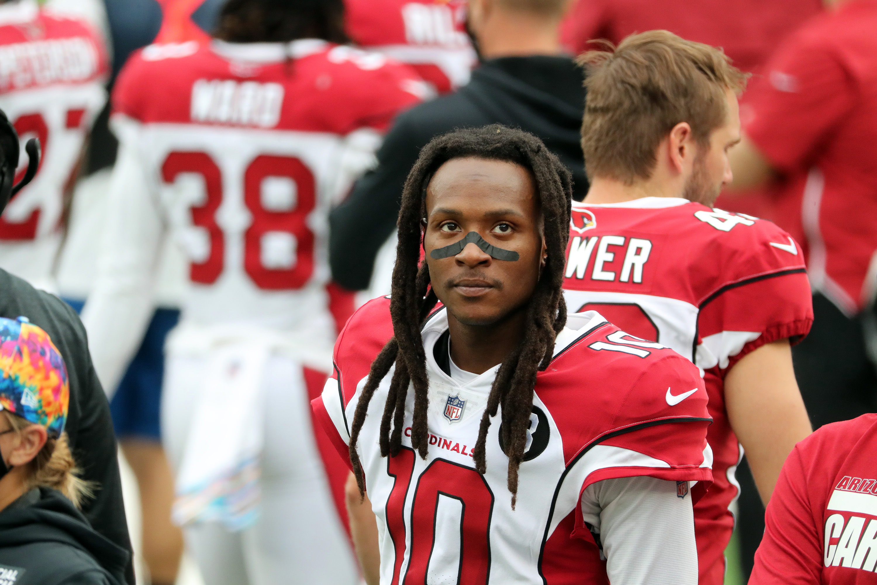 DeAndre Hopkins looks on from the sideline during a game