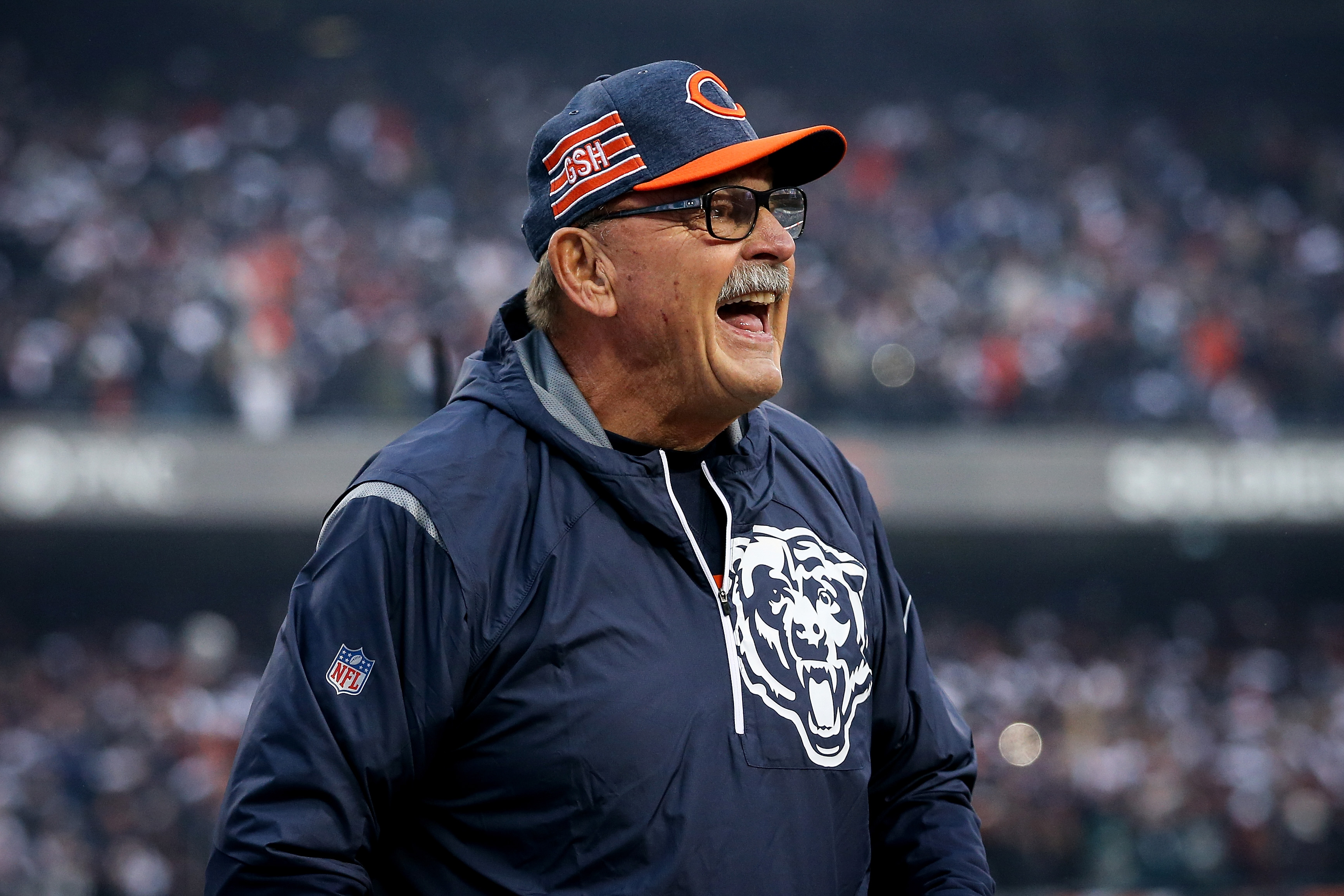 Dick Butkus watches a Bears game from the sidelines