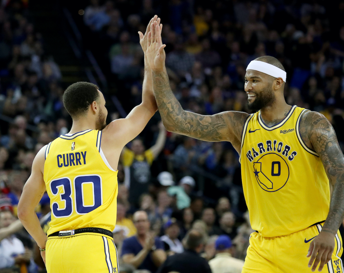 Warriors' Stephen Curry and DeMarcus Cousins