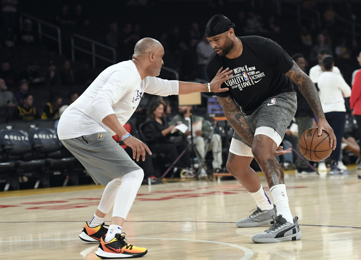 Lakers assistant coach Phil Handy working with DeMarcus Cousins