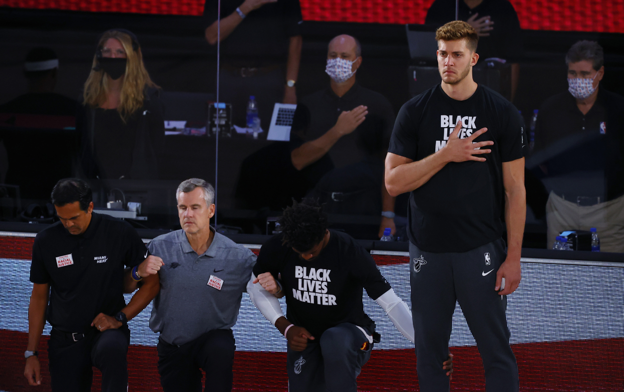 Meyers Leonard stands during the national anthem before a Miami Heat game