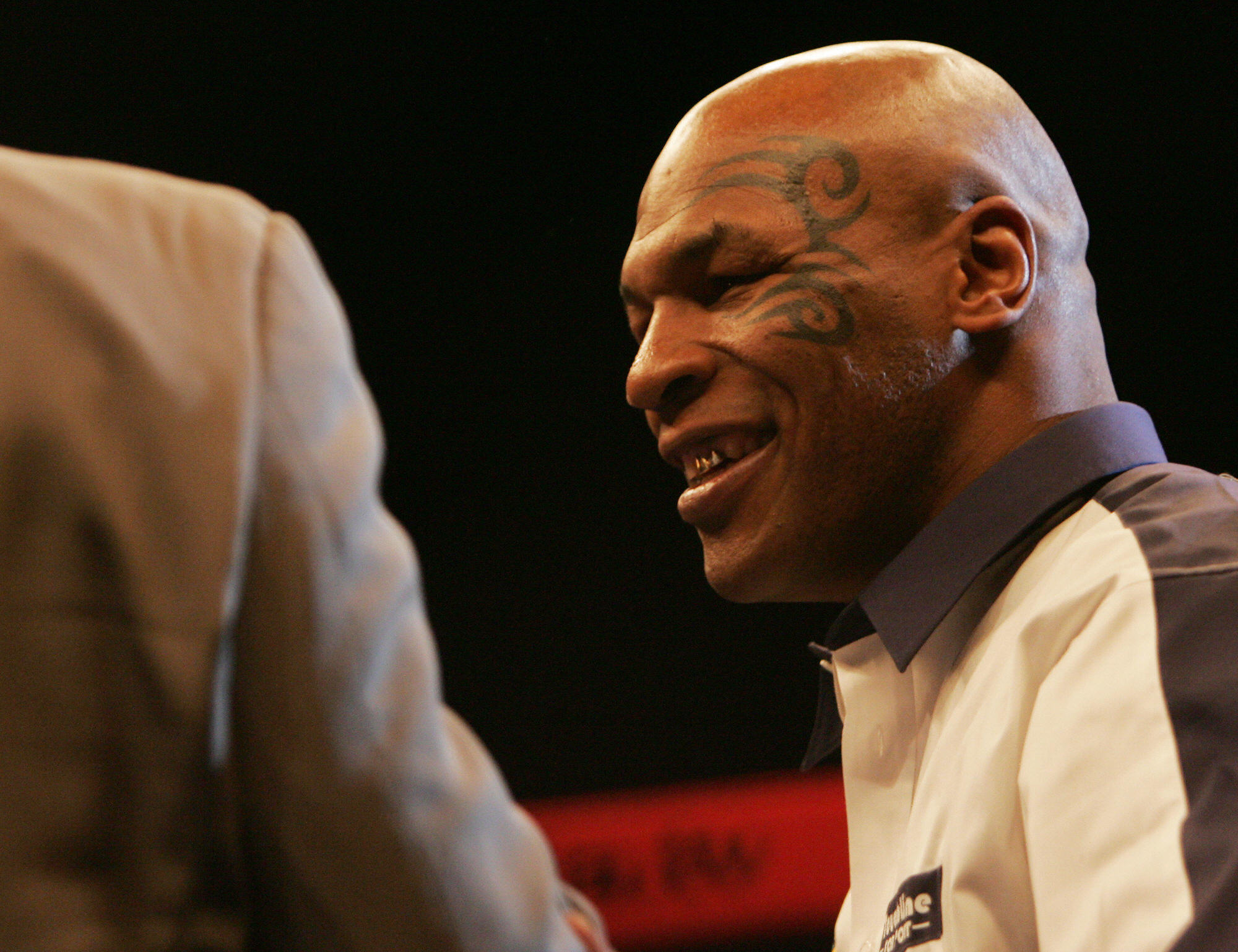 Mike Tyson smiles during an interview