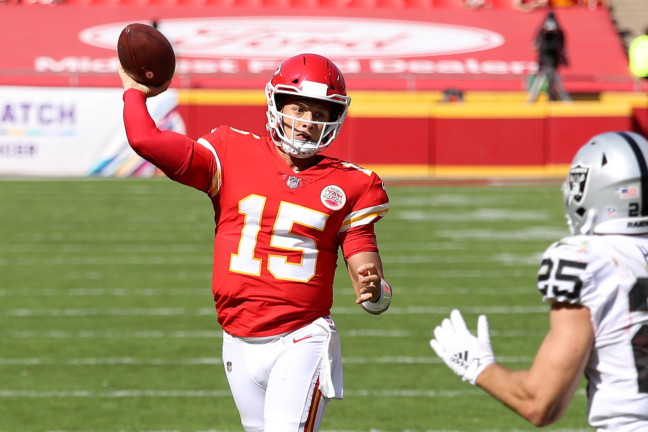 Patrick Mahomes throwing a touchdown pass