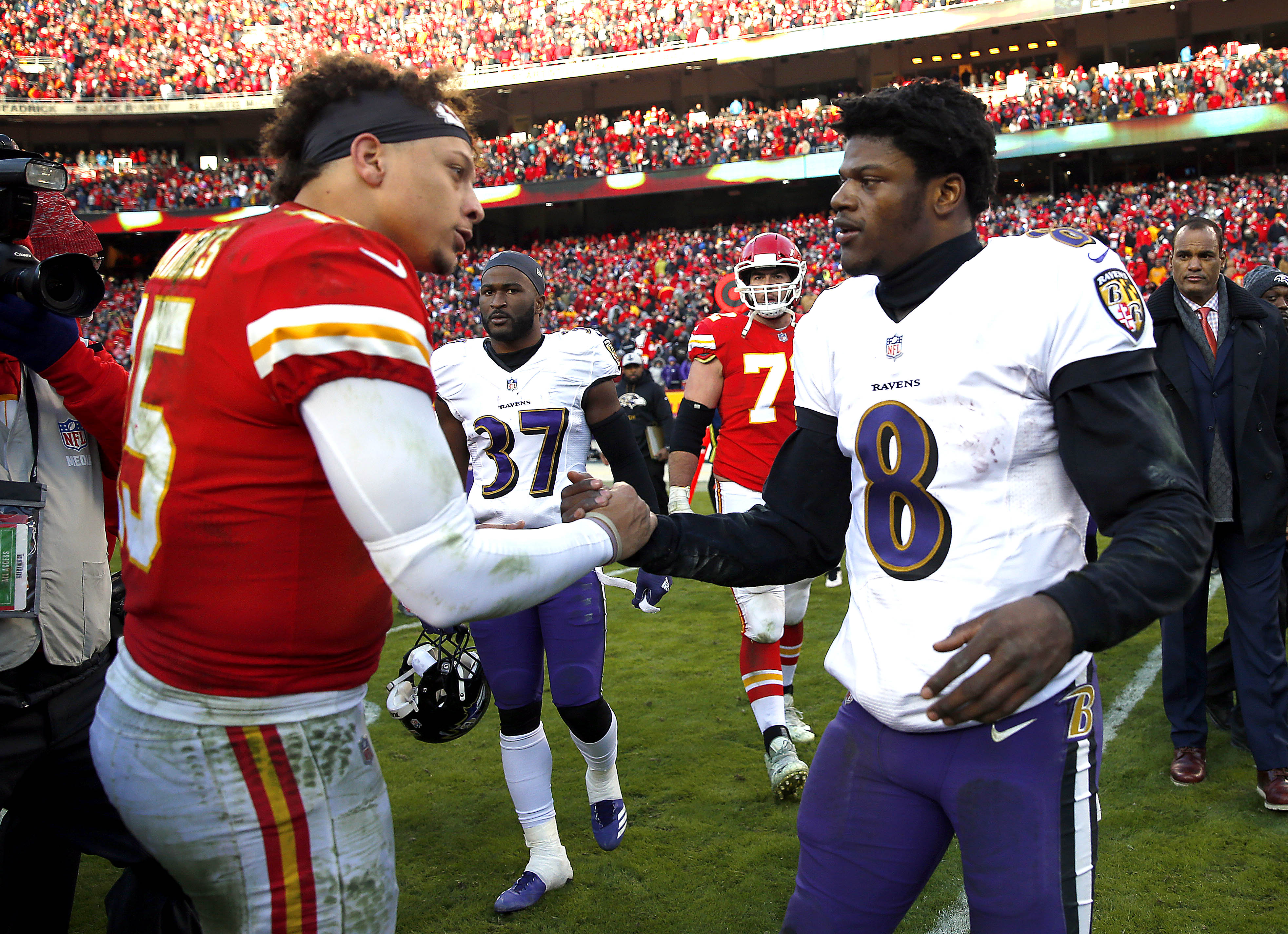 Lamar Jackson and Patrick Mahomes shake hands at midfield