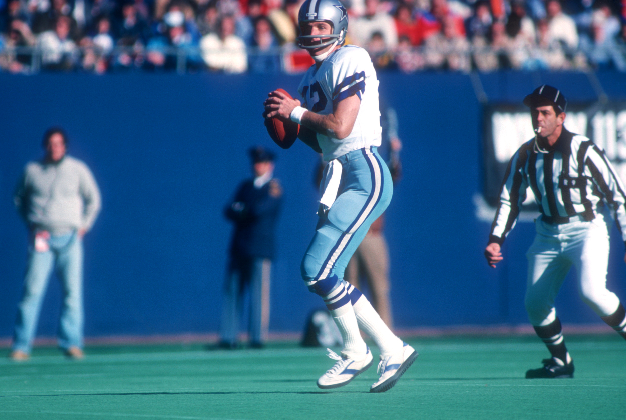 Roger Staubach drops back to pass for the Dallas Cowboys