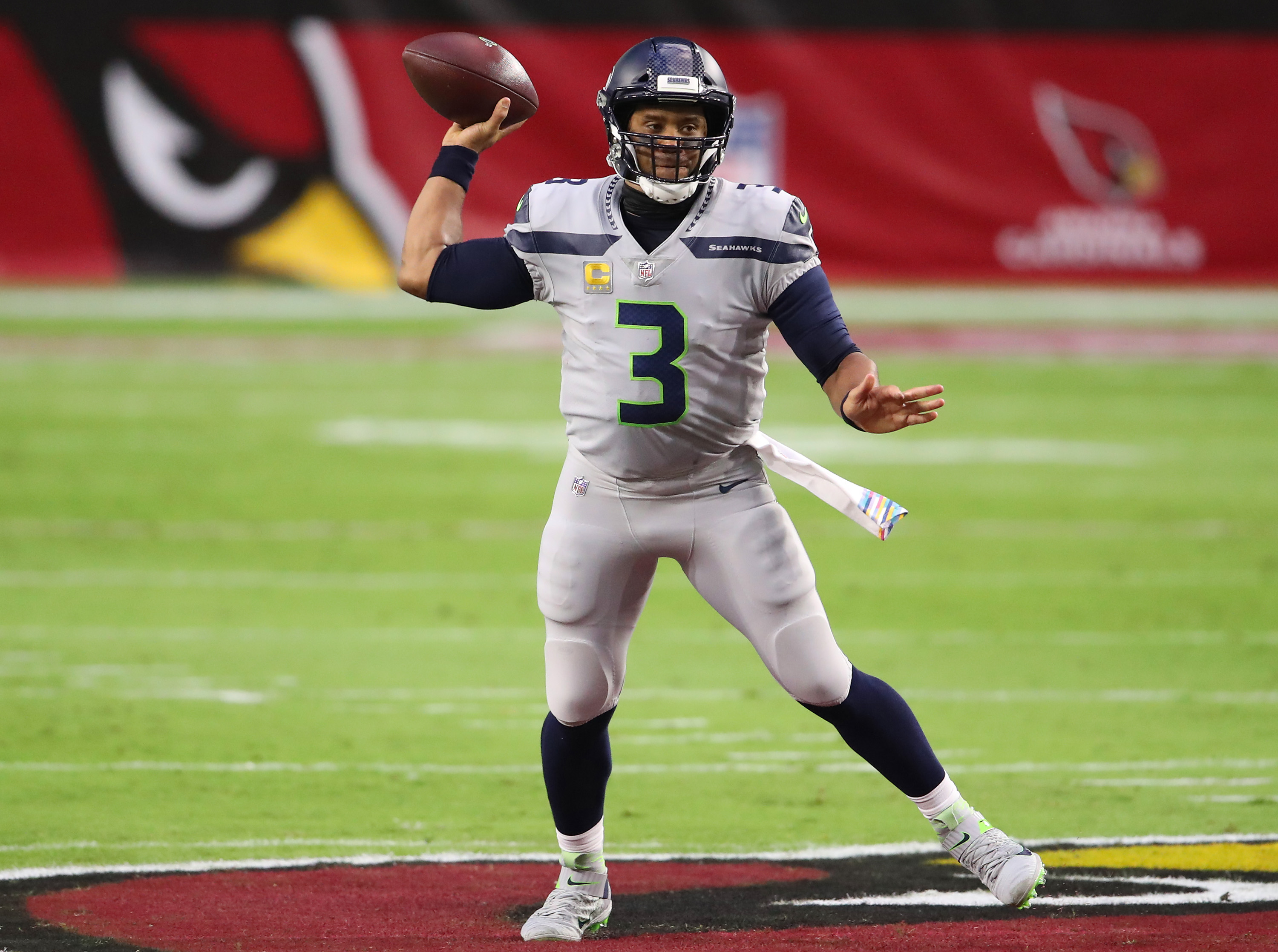 Russell Wilson passes the ball after scrambling